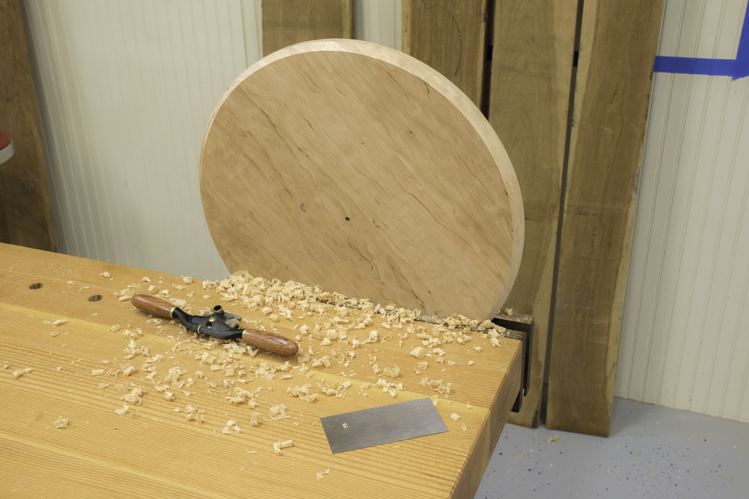 Cleaning up the edge of the circle after using the router circle jig.