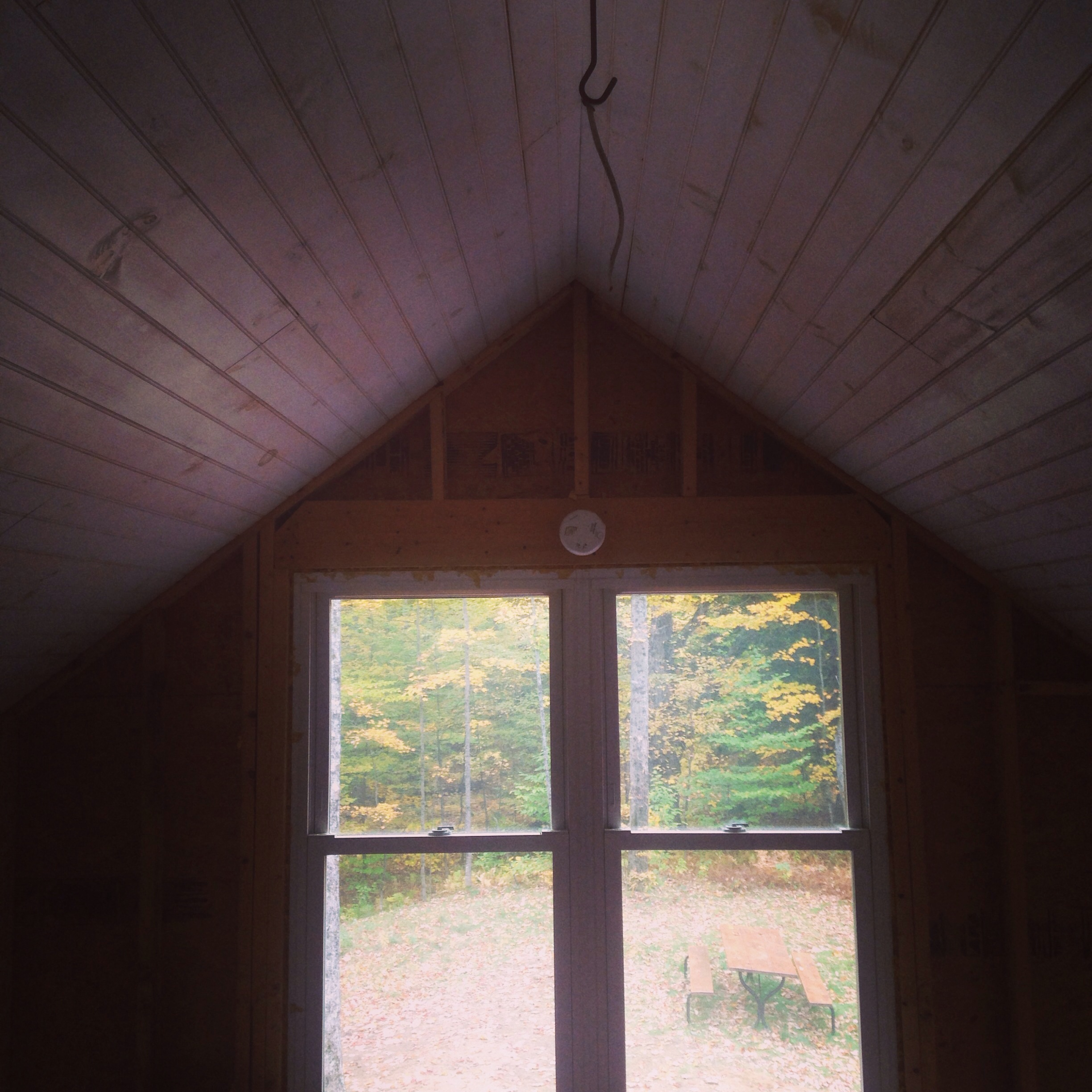 The view from loft space in our little 300 sq foot wood cabin - lanterns and blankets kept us warm nights