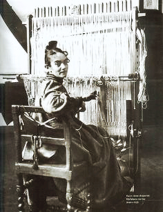 Larsson, an avid textile and furniture designer was the wife and muse of the late, Carl Larsson.  The textile depicted here is attached to her original loom.  While raising her eight children, Larsson still designed all the furniture and textiles in her home.  Above: Larsson at her loom
