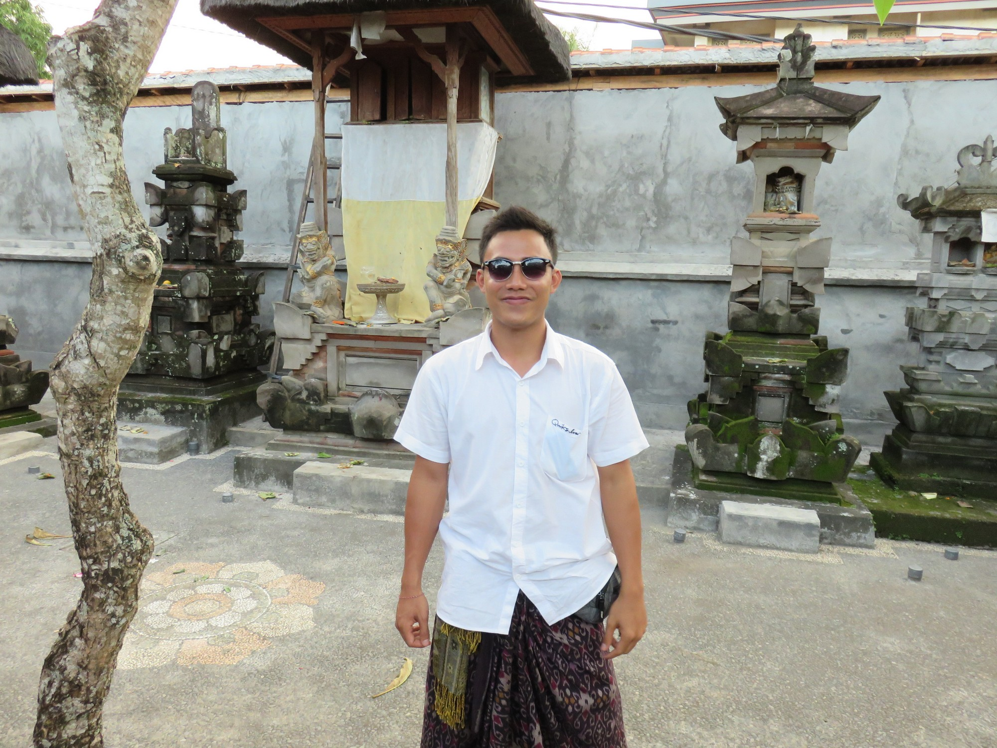 Our amazing guide Lionk in his family temple