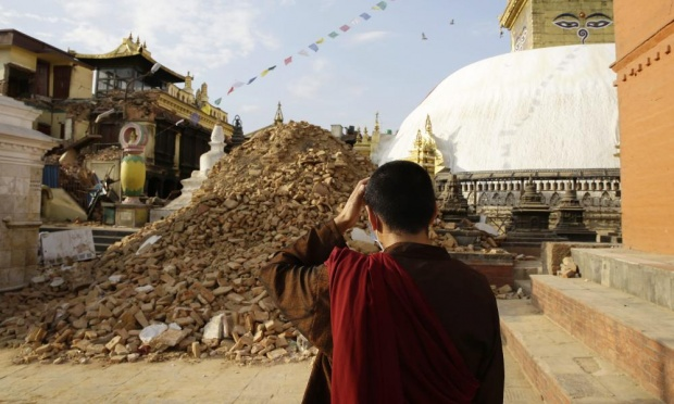 Monk examines damage at Swayambhunath Stupa, April 26, 2015.