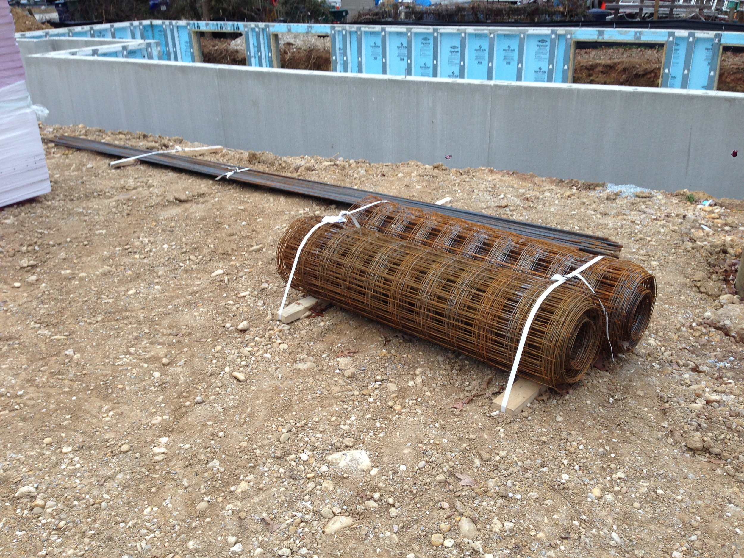 Some materials for under the slab. R10 insulation on the left, rebar for the footing and steel mesh for the slab.