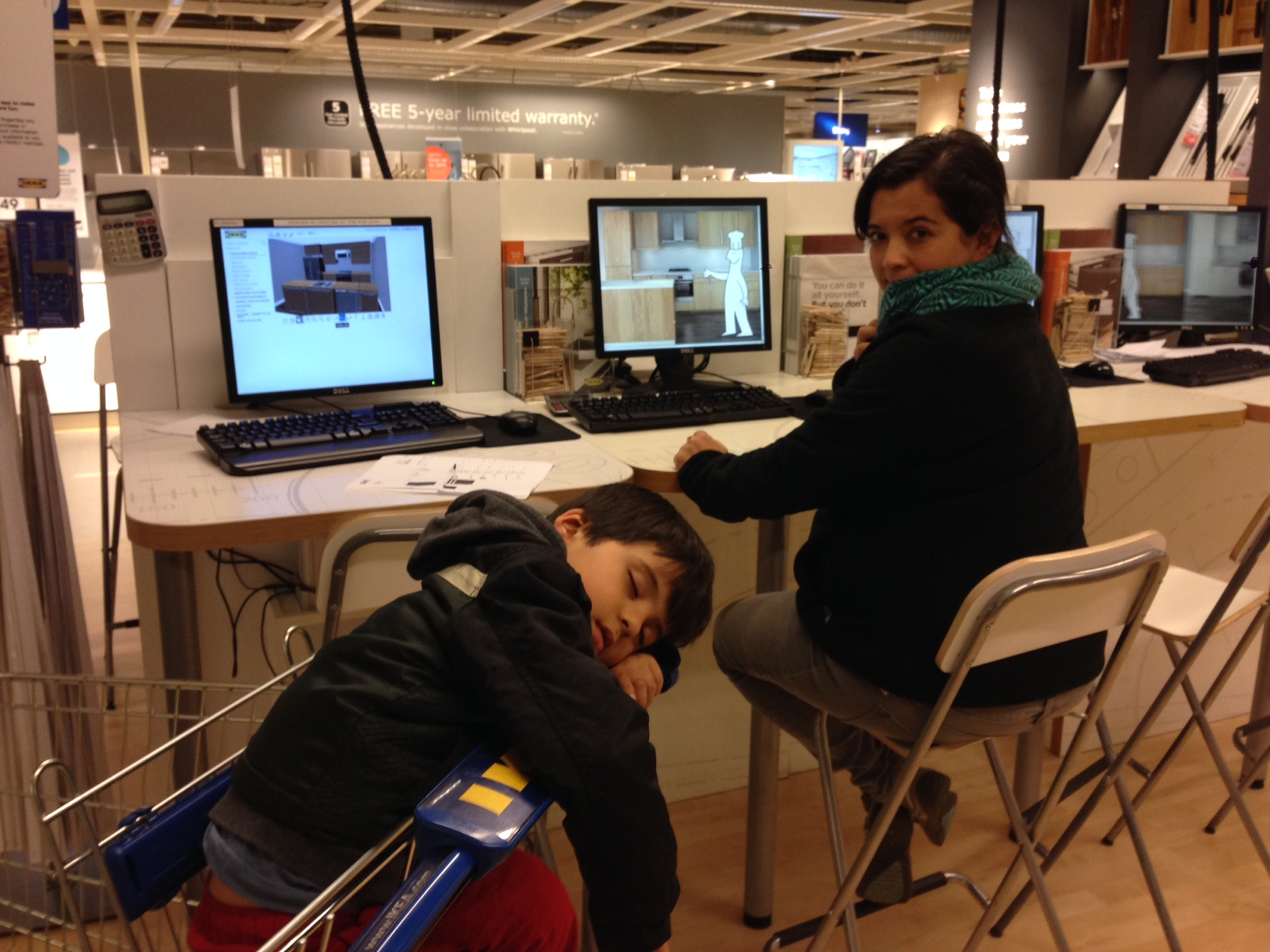 Finalizing our kitchen cabinet order at IKEA. Pedro has had enough of these shenanigans and Daniela isn't far behind. there is a lot to buy!