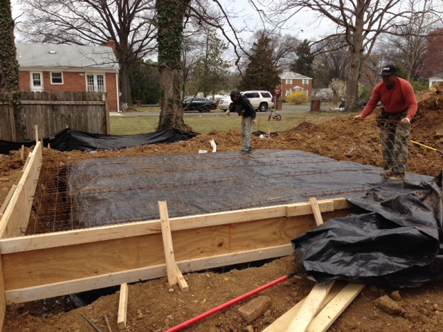 Wire mesh being placed for the slab. The footing around the slab is 2' deeper due to the soils conditions. We will have one strong garage slab!