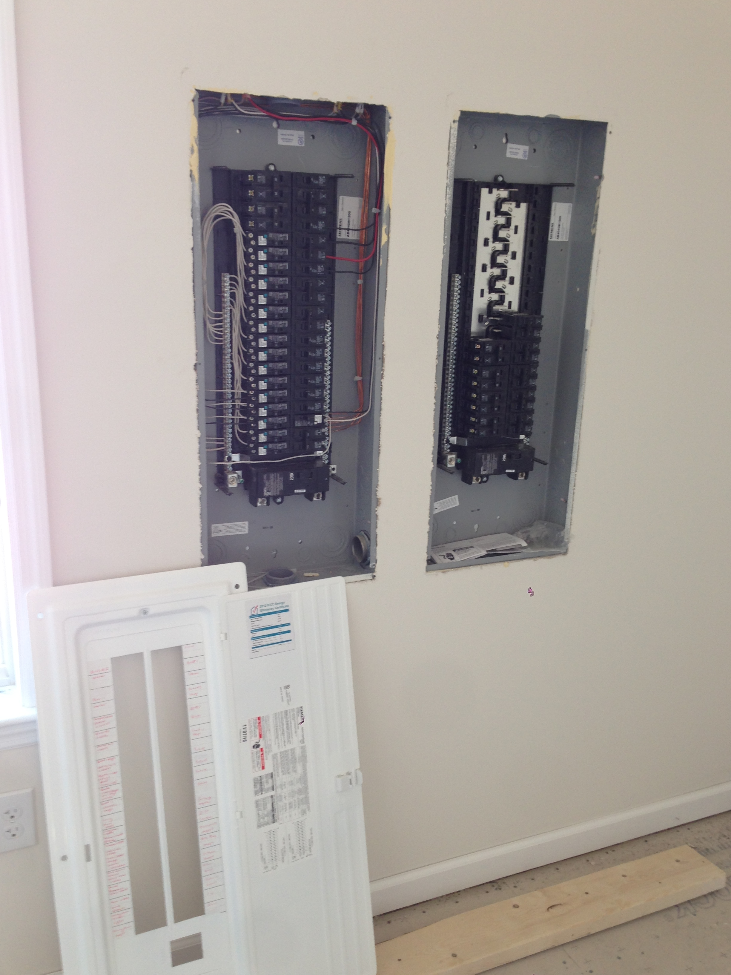 Electric Panel removed. The one on the left are for the first two floors as provided by Excel all pre-wired. The right panel is for the basement and any other items added on site.
