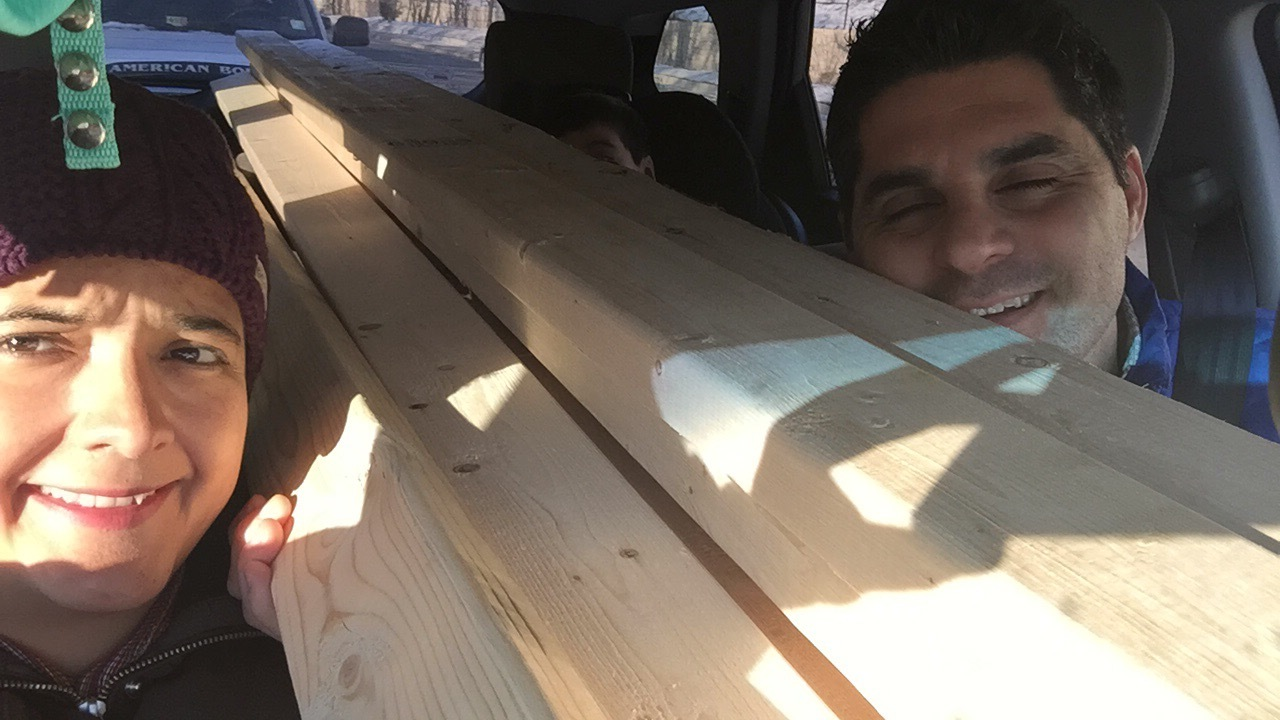 """Squeezing into the car with 8 - 2"""" x 4"""" x 10'. Pedro is somewhere in the back. We promised our car that after we are done with the house we will treat it to a detail. Maybe two."""