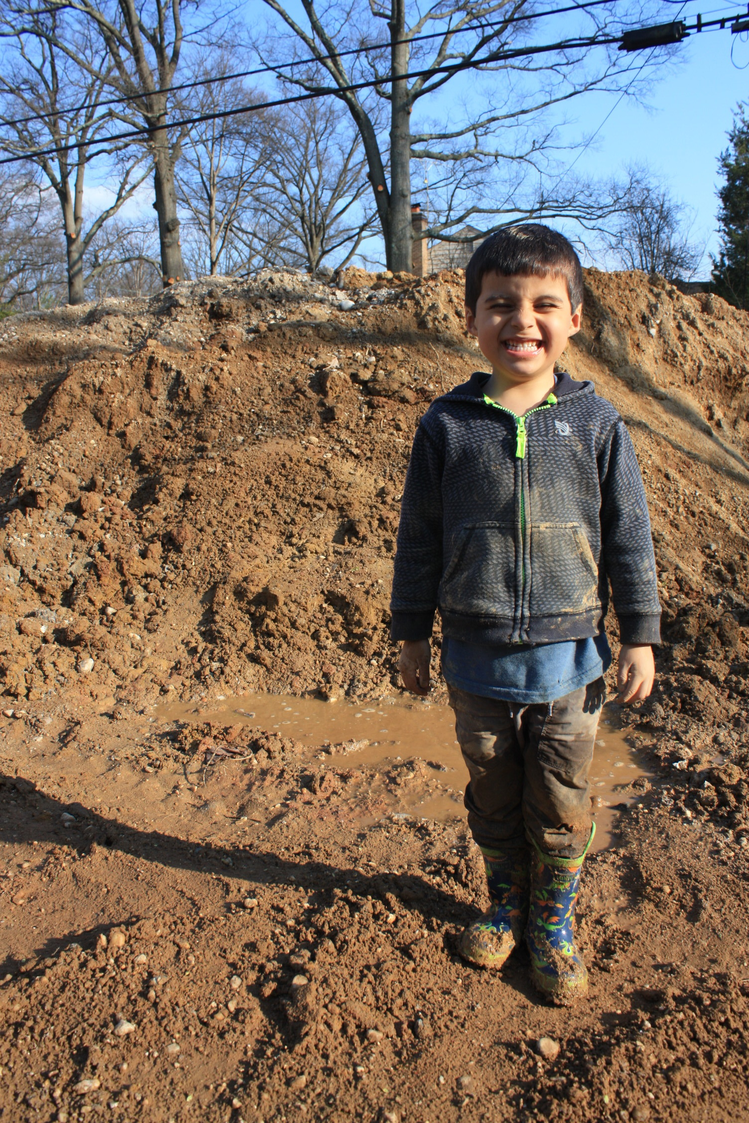 Pedro was able to find all the mud and then some. Needless to say this is his new construction clothes.