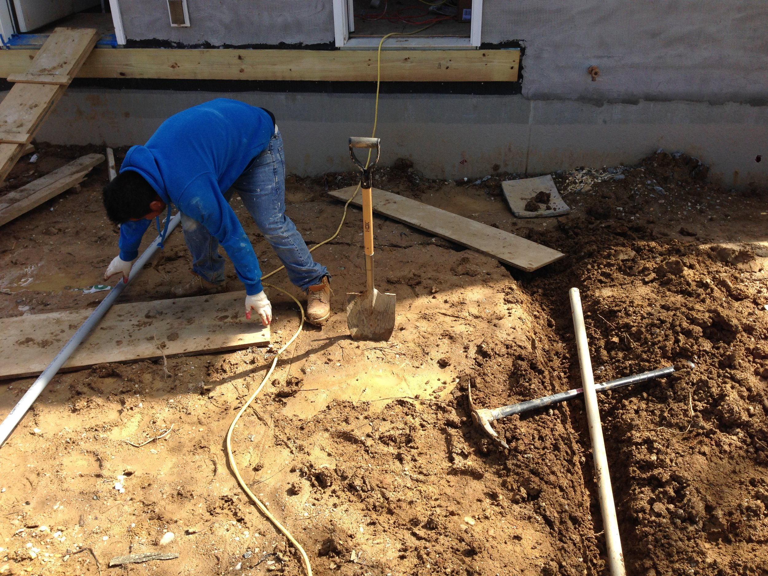 Installing the electric conduit to take the wiring from the house to the detached garage.