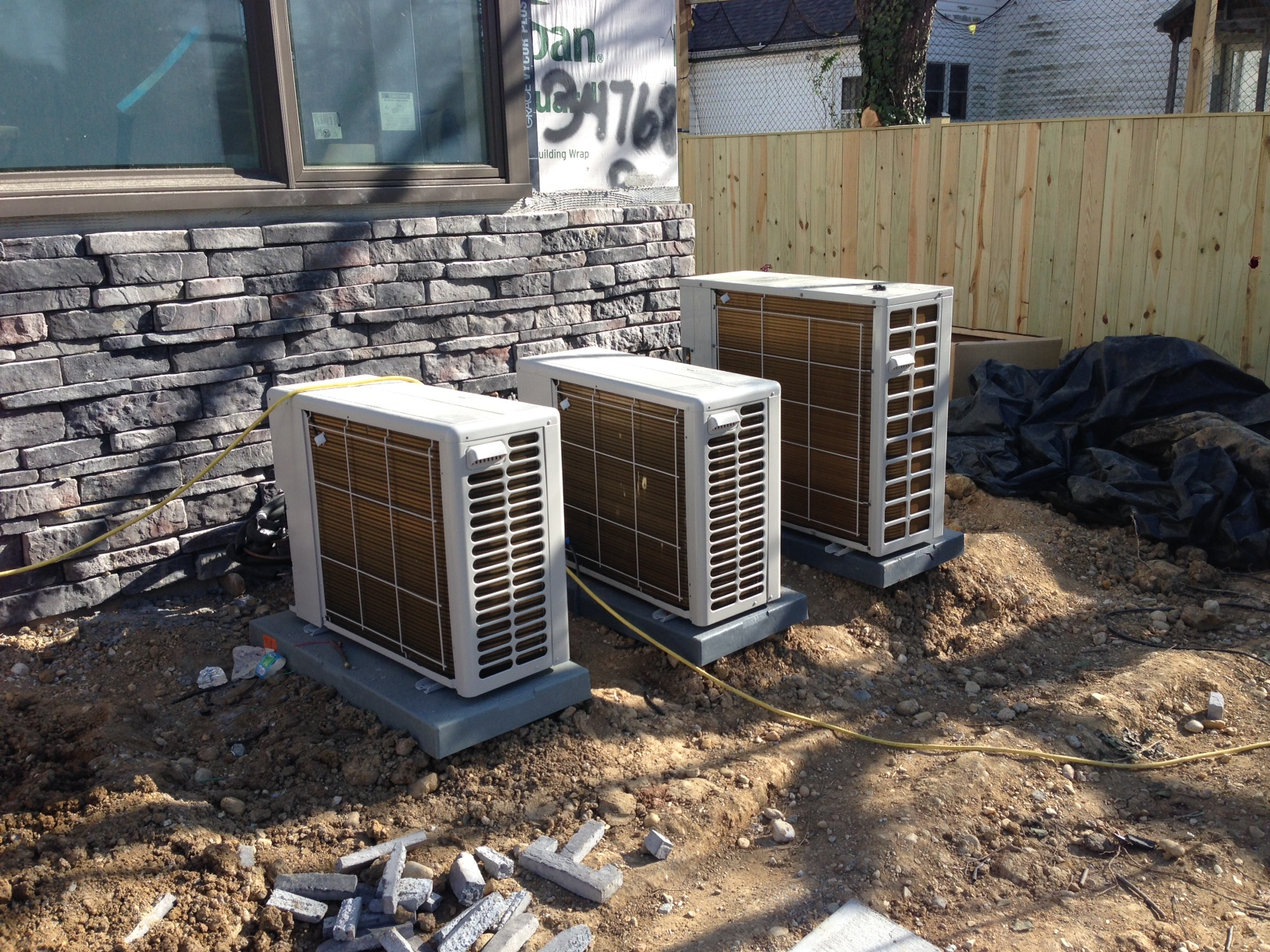 The minisplit condenser units installed. These will bring heat and cooling to 9 rooms throughout the house. Each room is individually controlled.