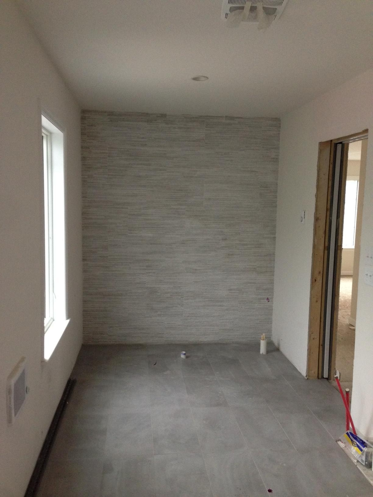 Soon a stand alone tub will be located in front of our beautiful tiled wall. Soon.