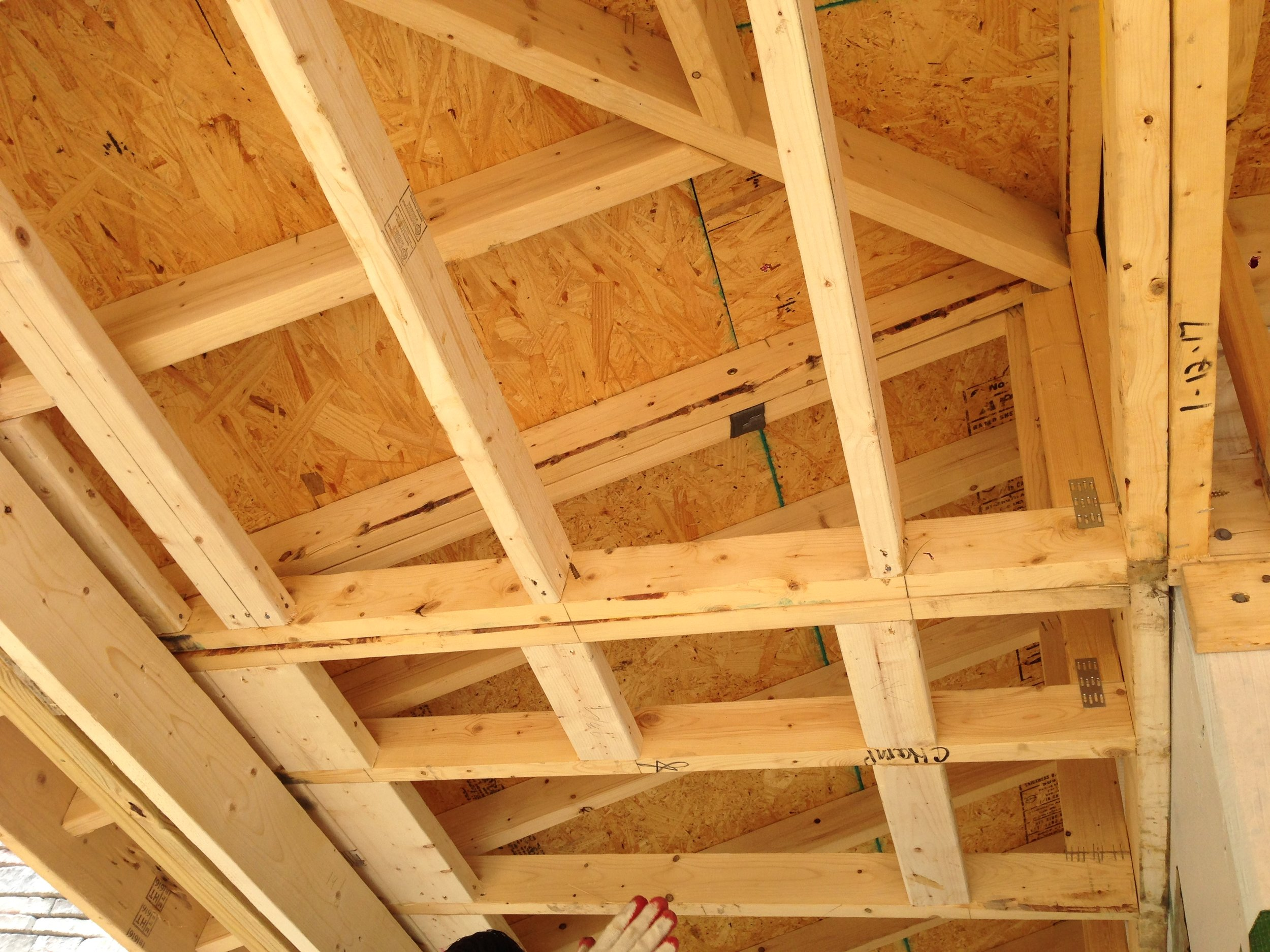 Jose installing some blocking in between the rafters.