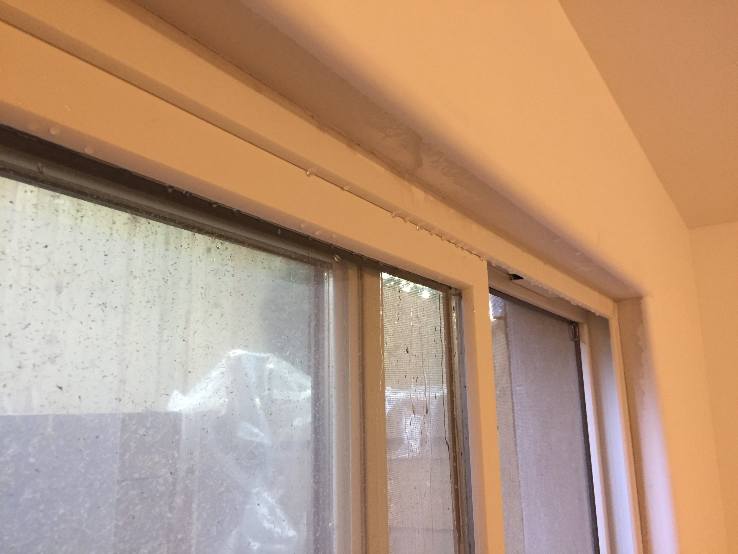 Water dripping from the top of the window. Where is it coming from?