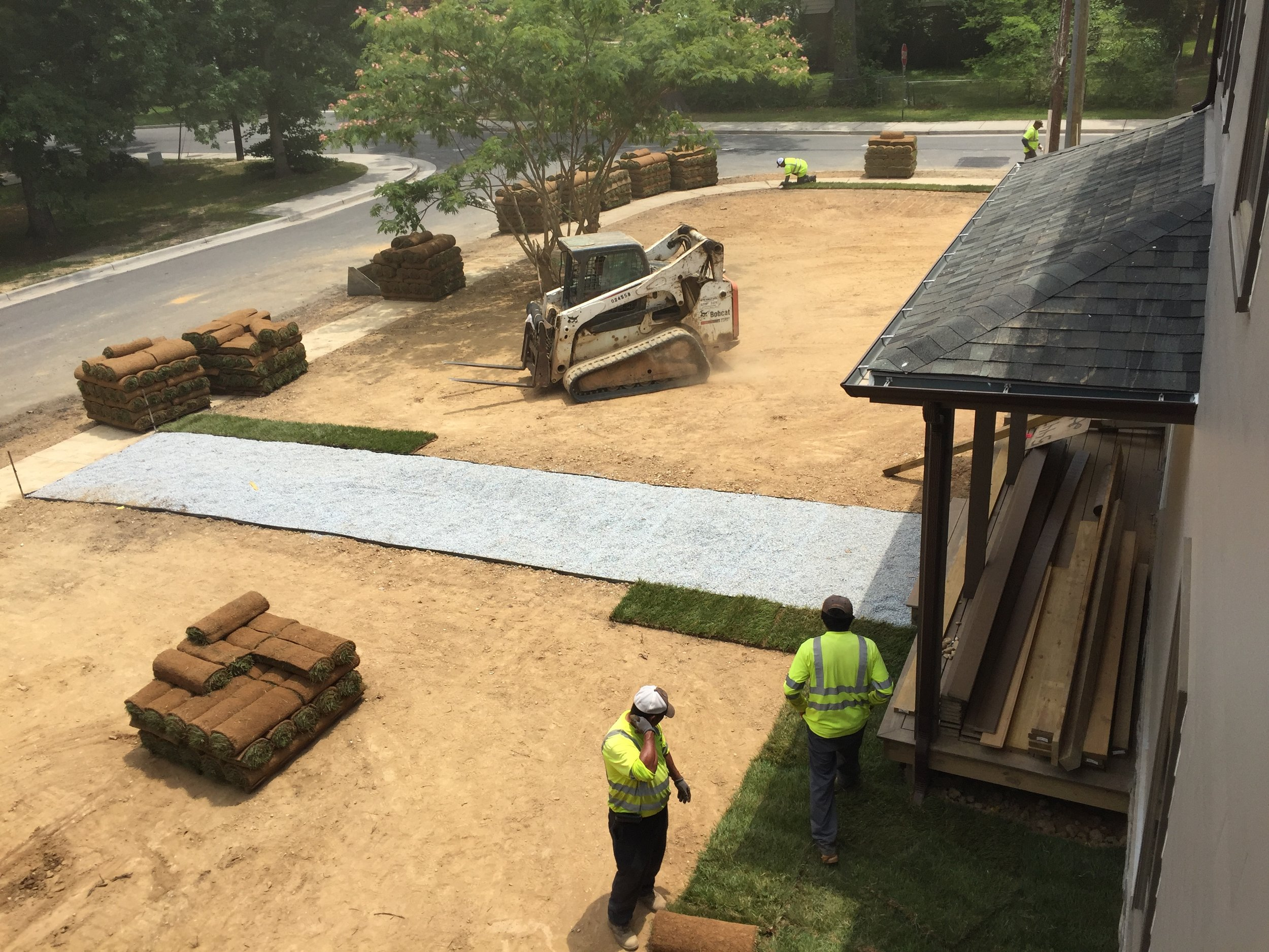Sod starting to get placed after the morning crew cleaned the site. Notice how smooth the dirt looks.