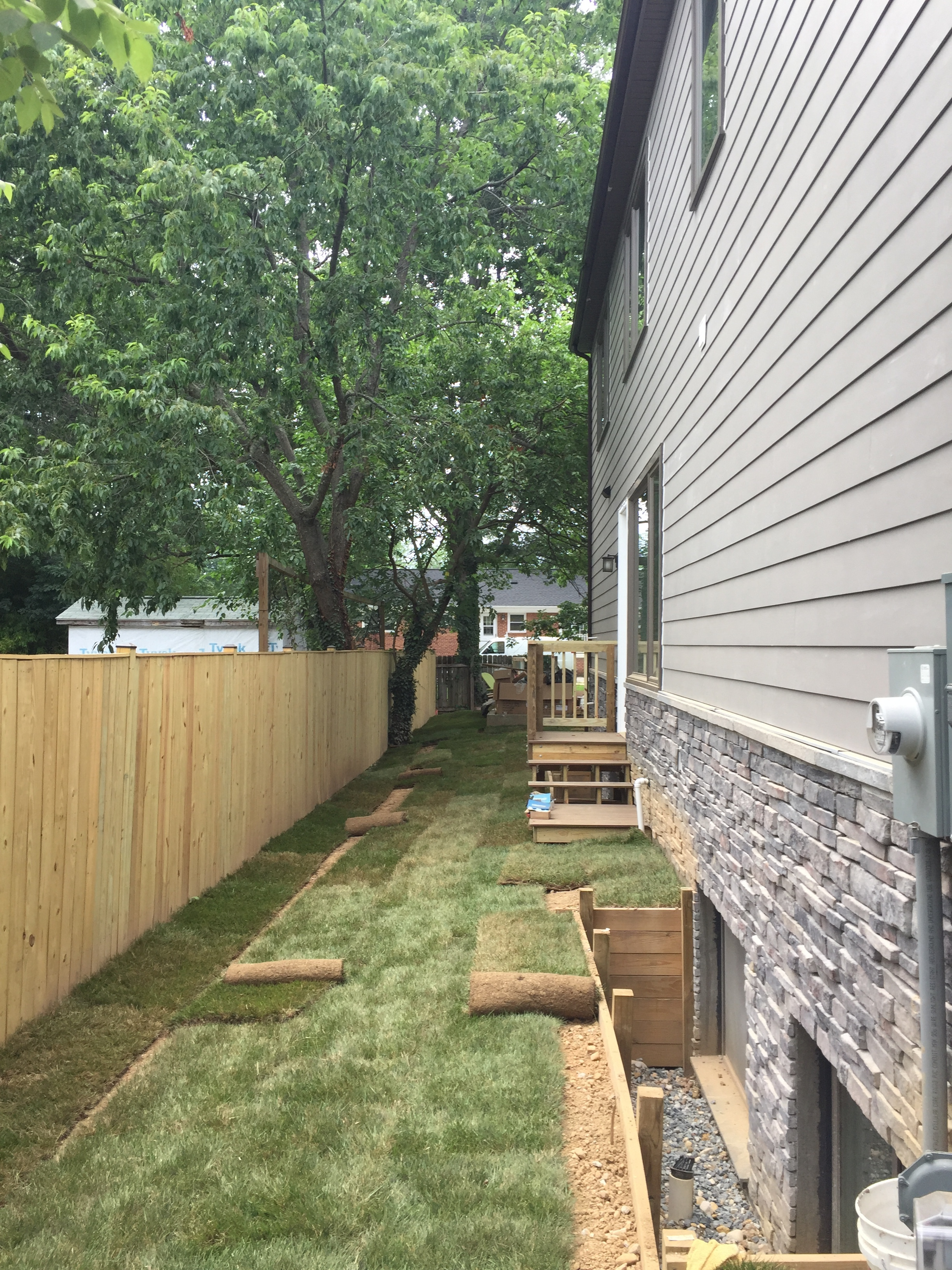 Sod being installed along the side yard. The sad part is that I have to fix the window wall retaining wall so I will have to rip up some grass and replace some wood. Lesson learned.