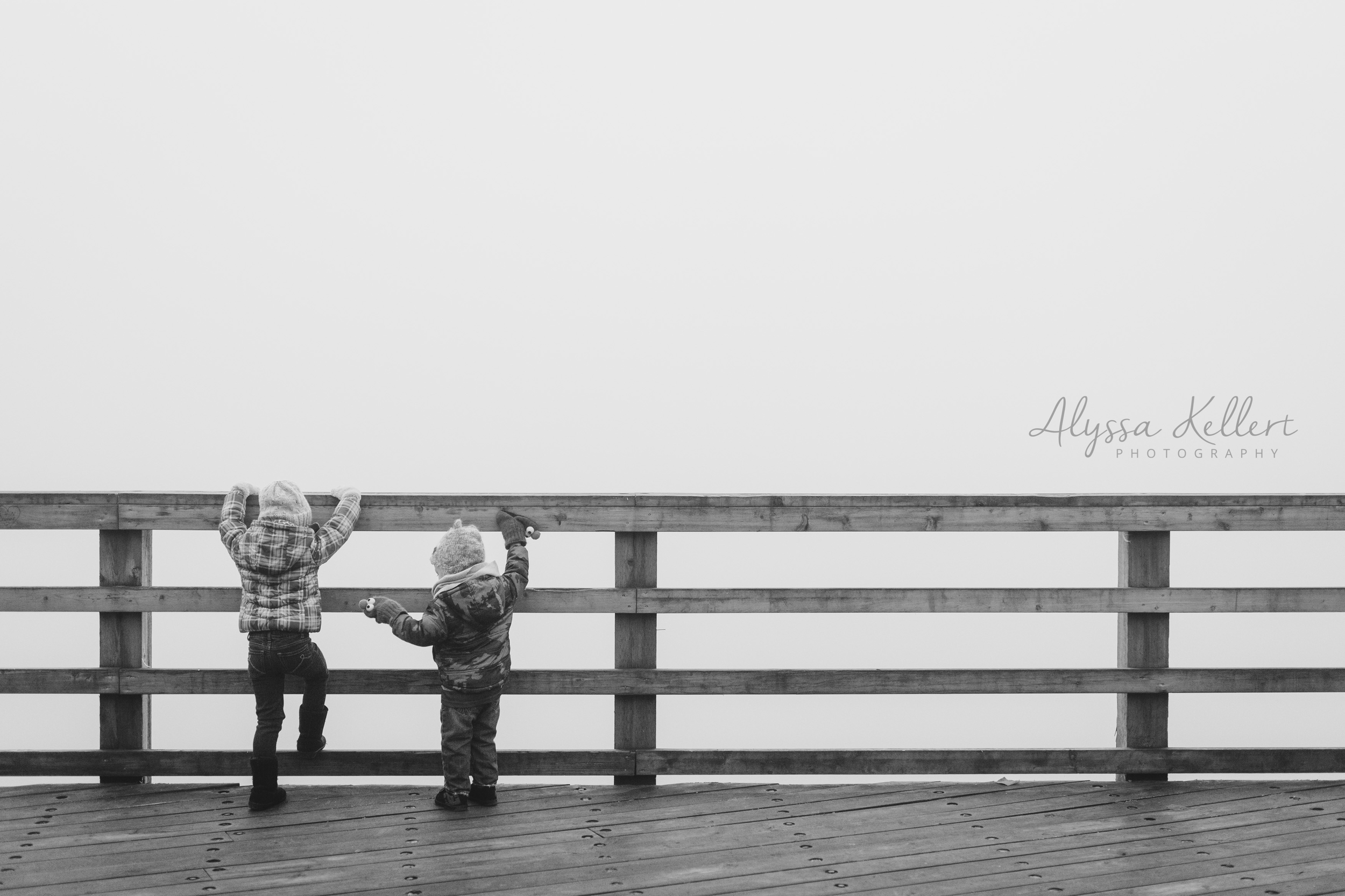 two-kids-bridge-winter