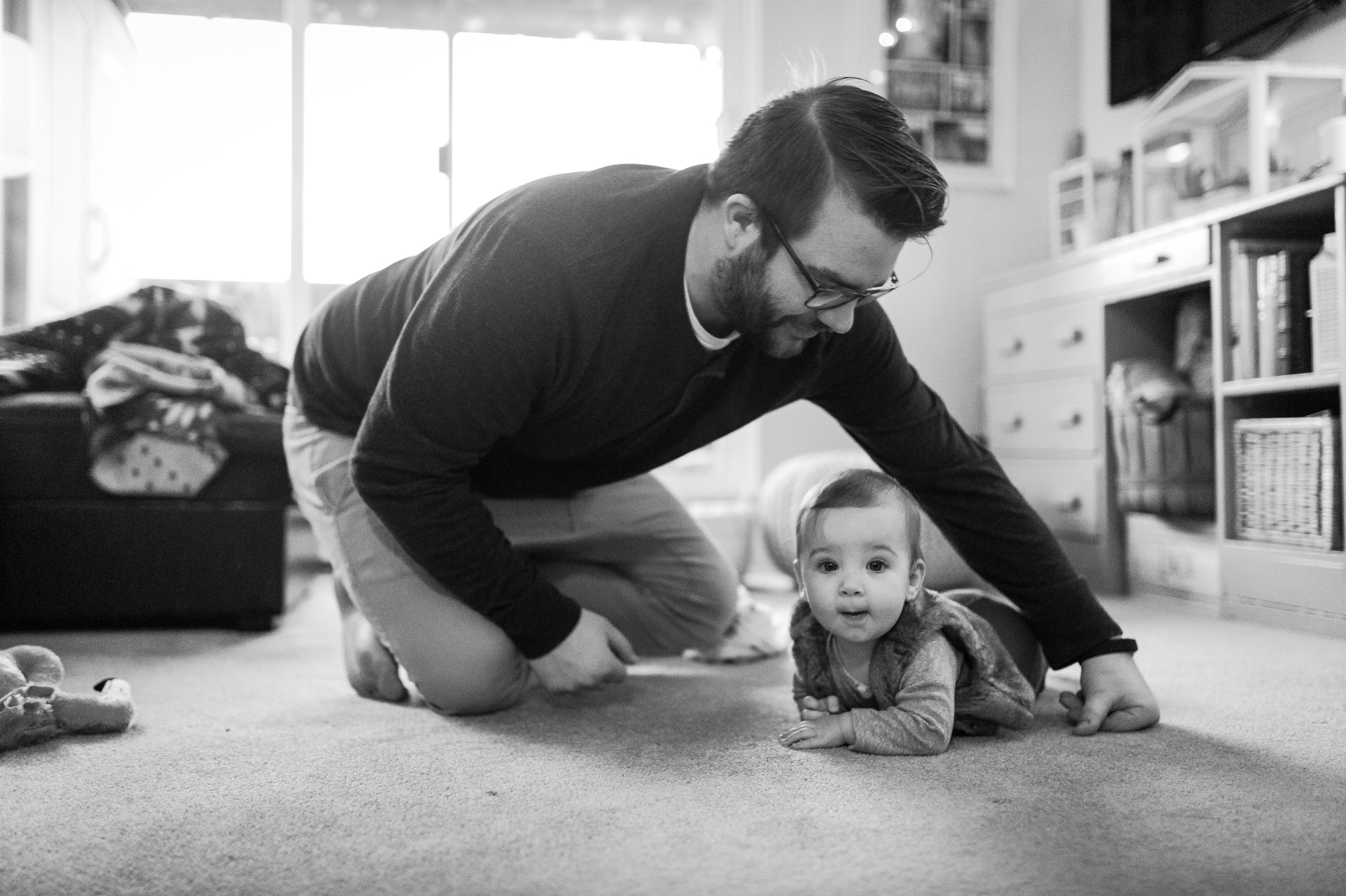 family-film-documentary-dad-baby-playing-floor-toys-vancouver