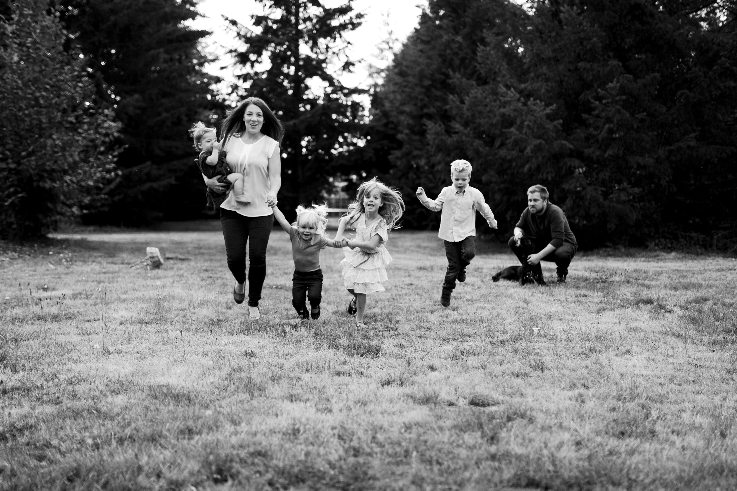 family running together towards the camera during a photo shoot