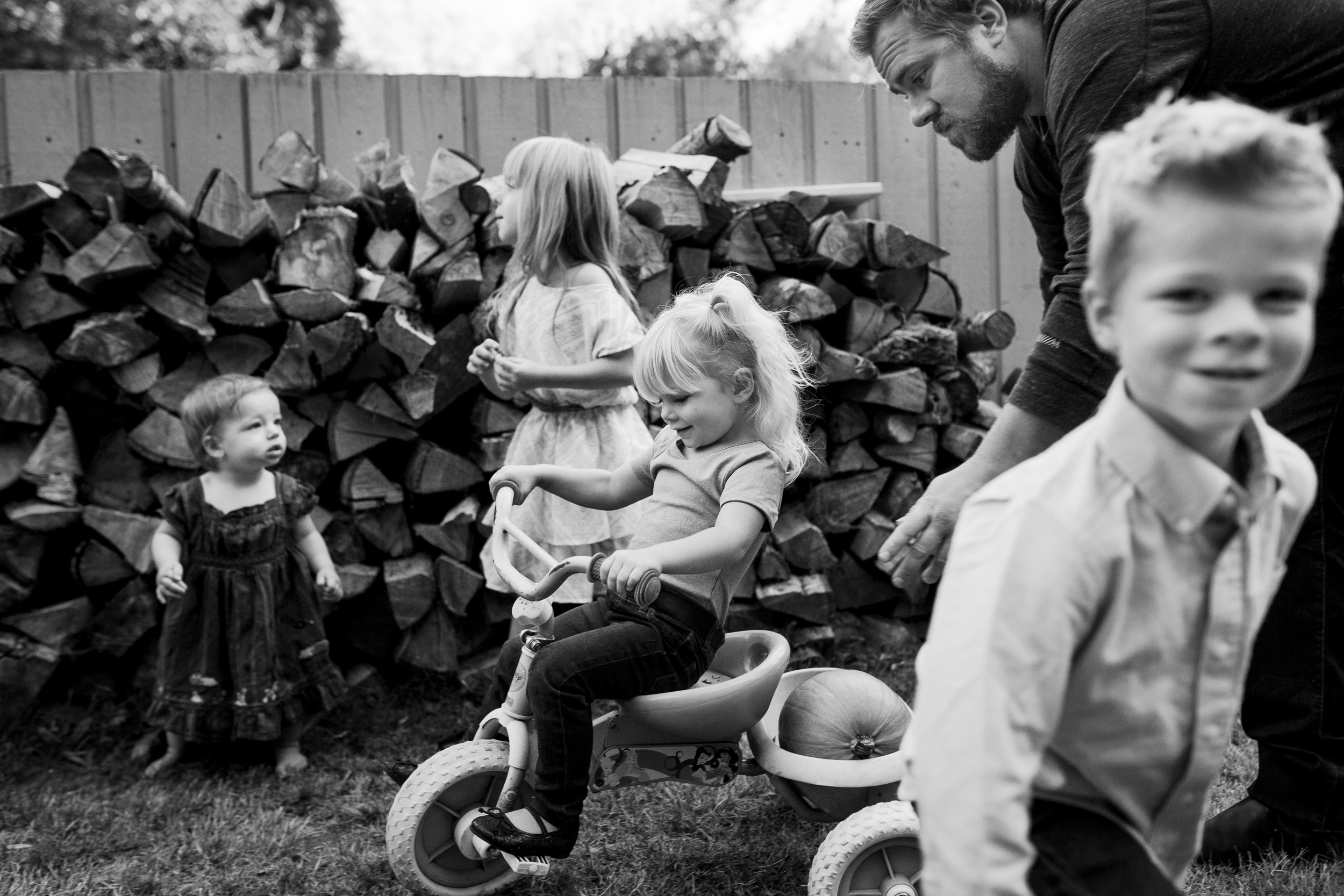 family in the busyiness of four kids together playing