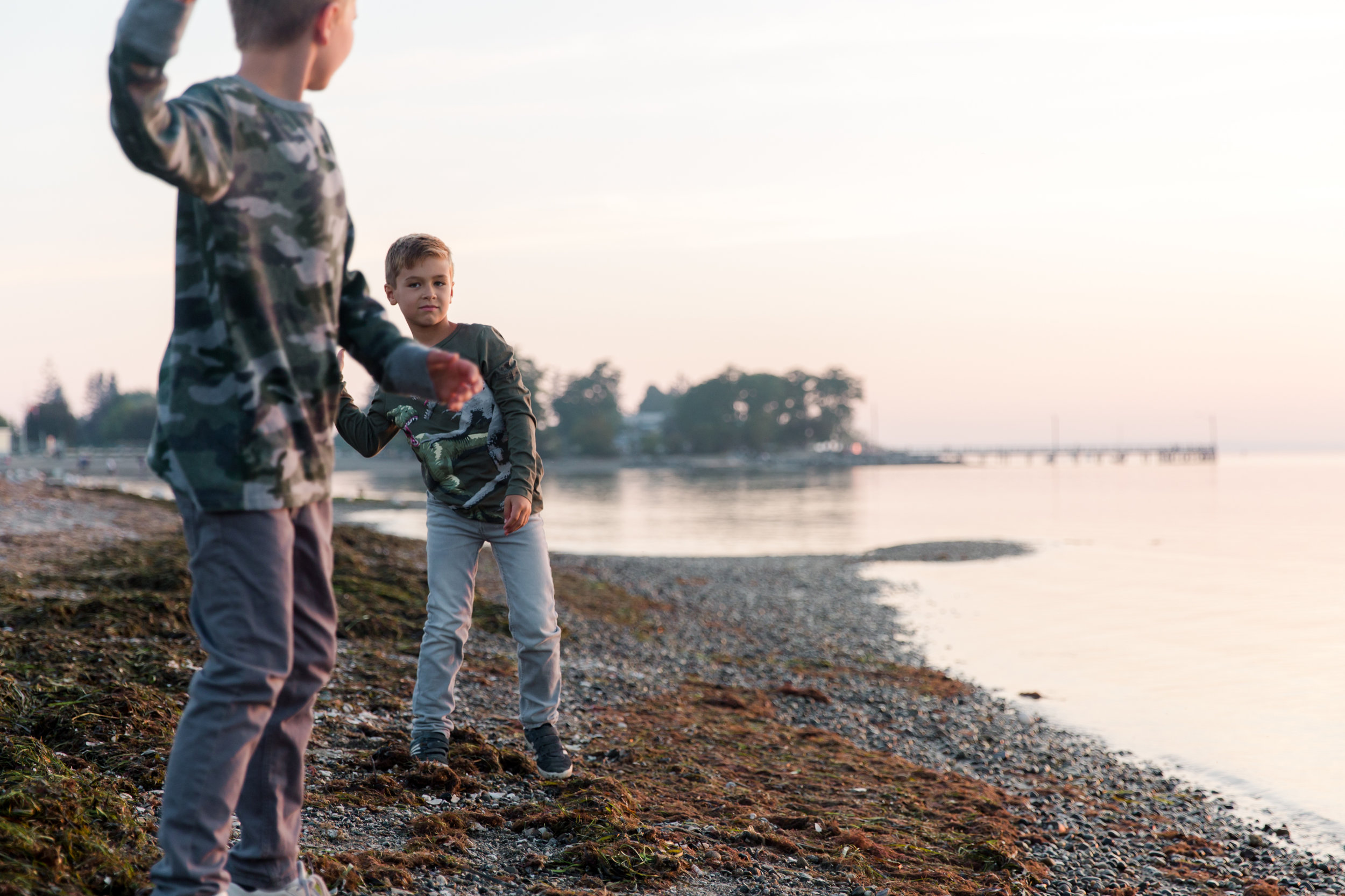 boys throwing rocks at the beach in south surrey