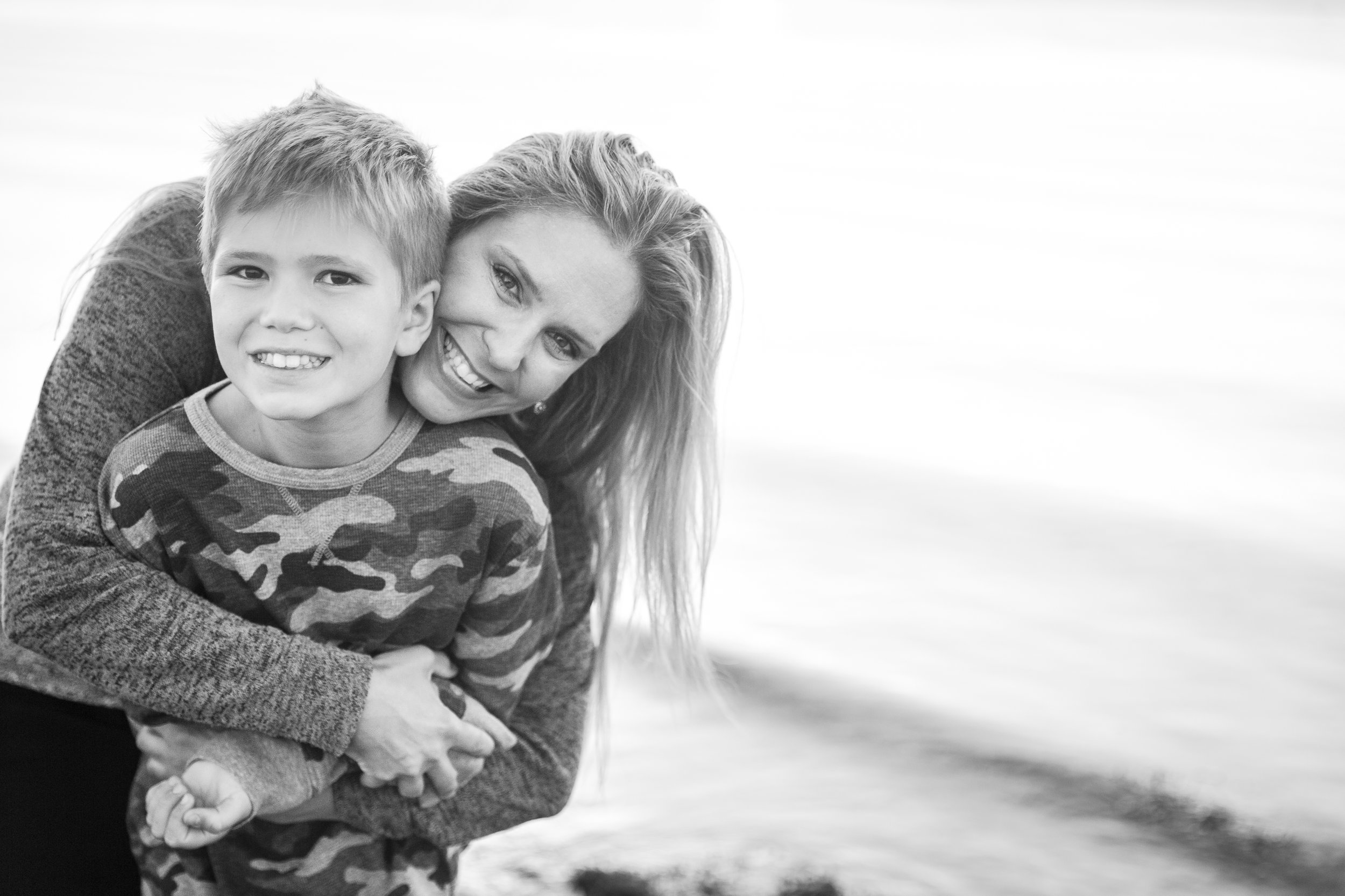 mom with son on the beach in surrey