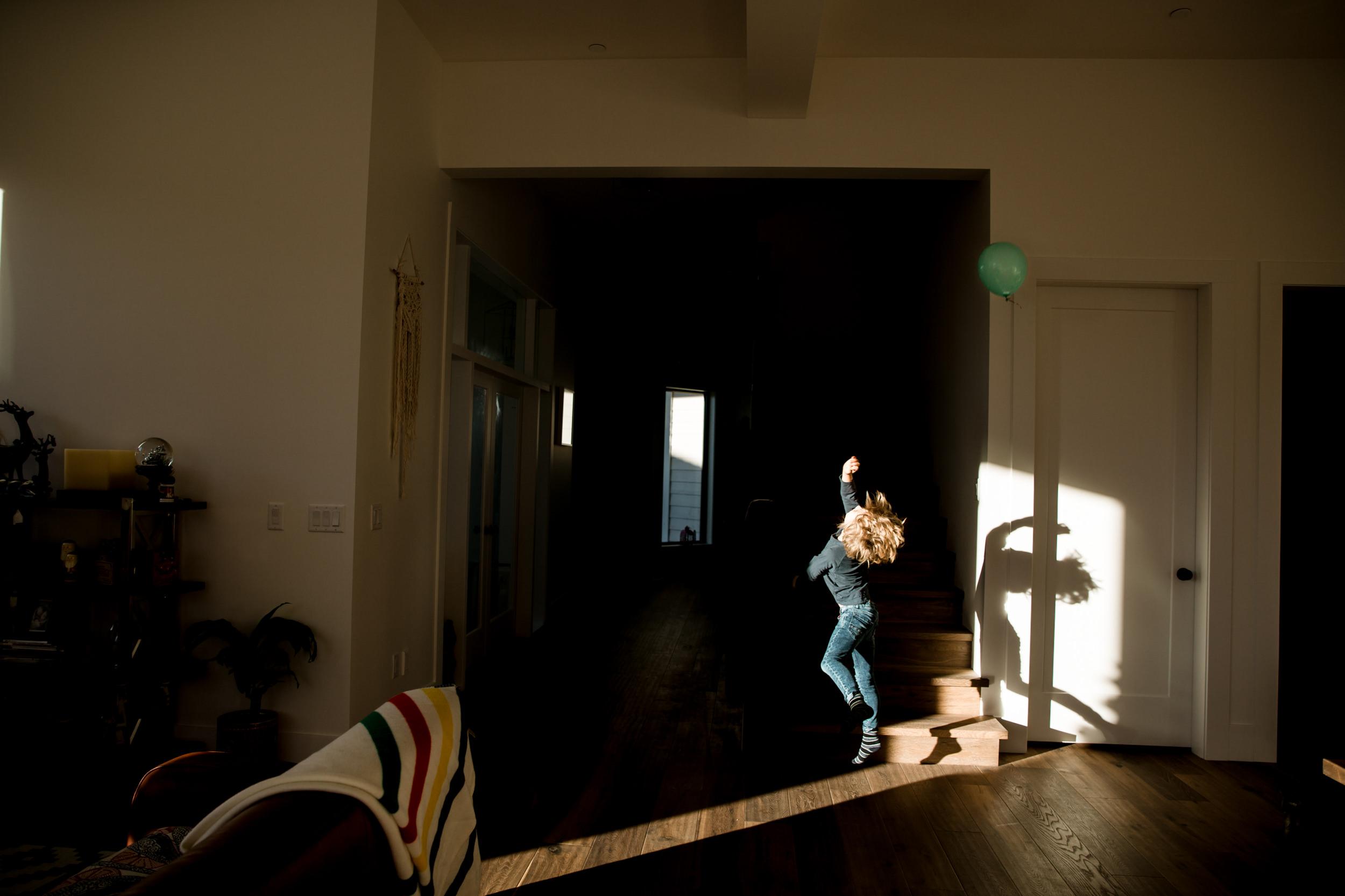 boy-hitting-balloon-in-air