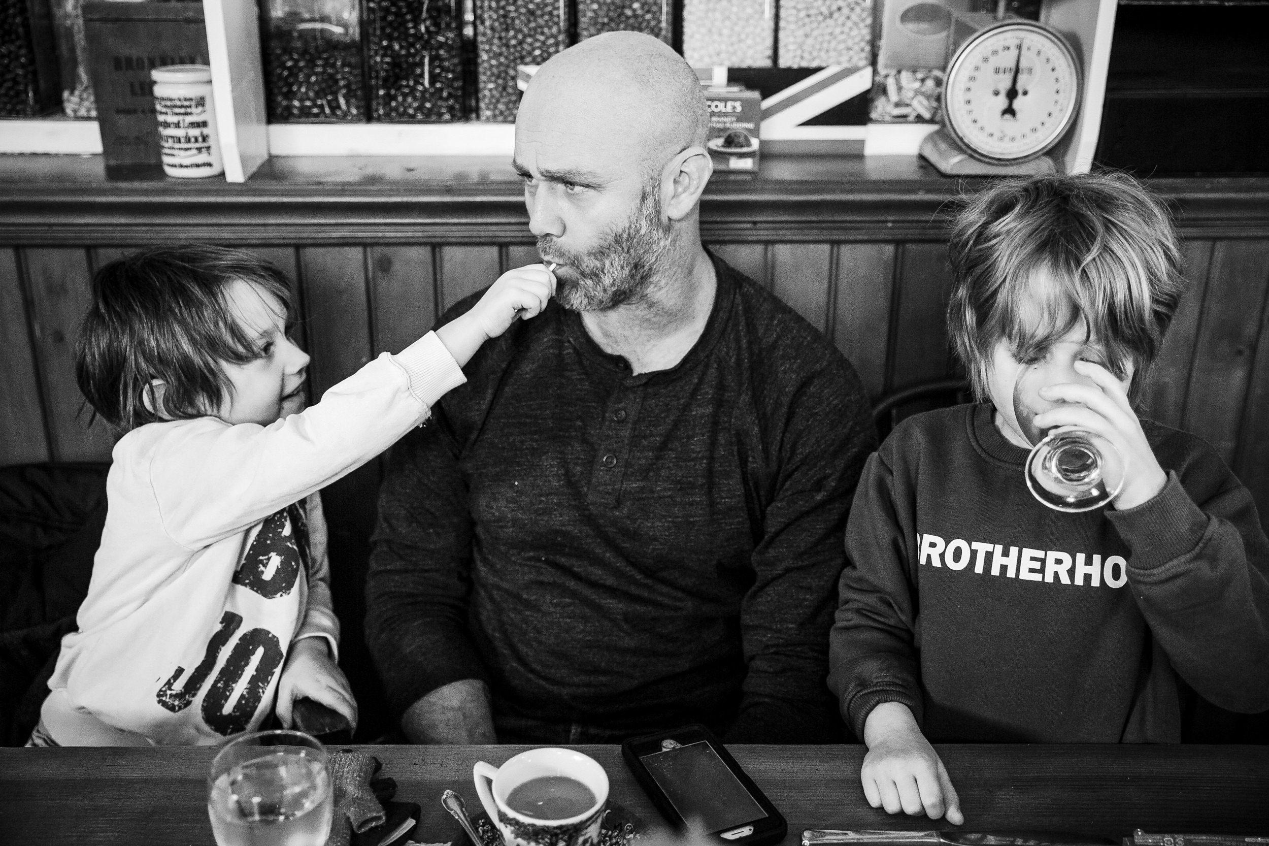 kid-feeding-dad-sucker