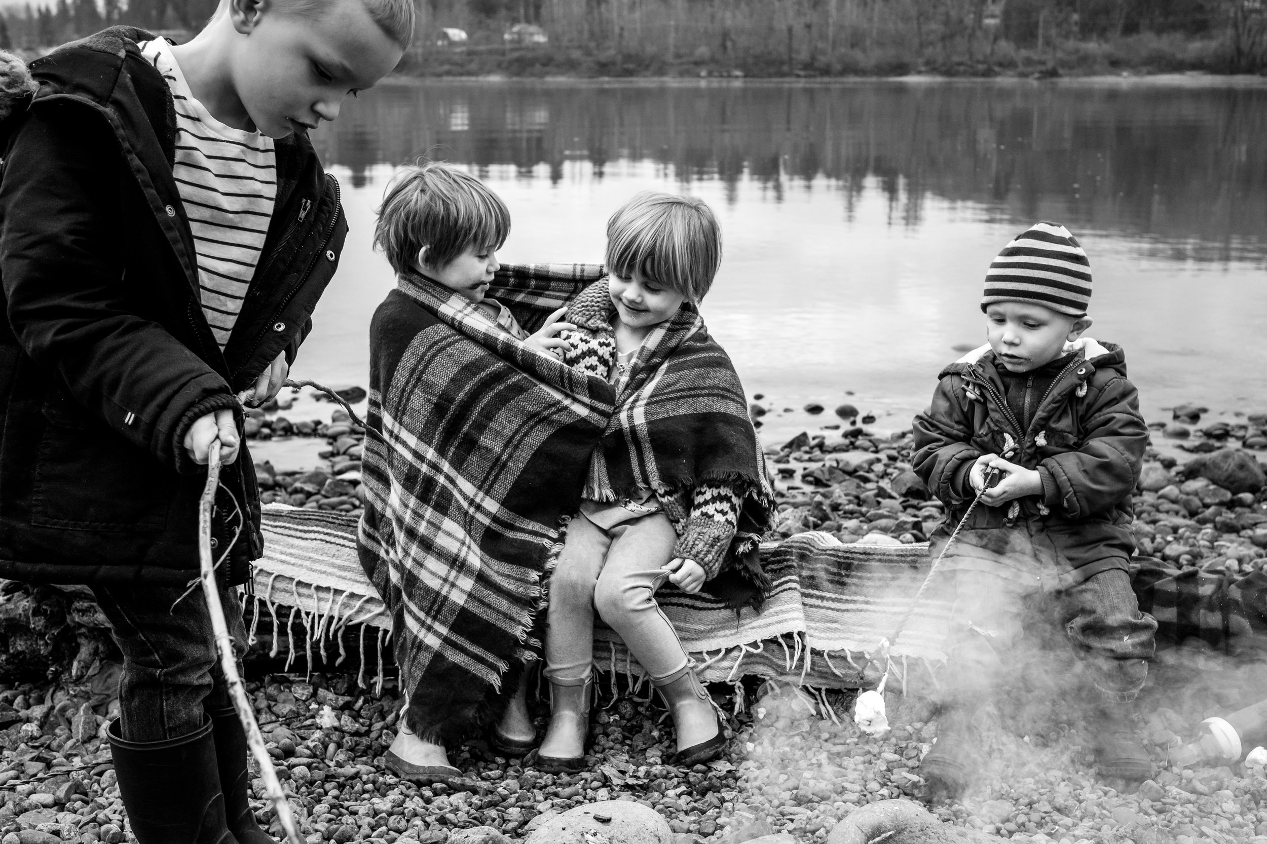 kids-camp-fire-marshmallows-water-river-rocks