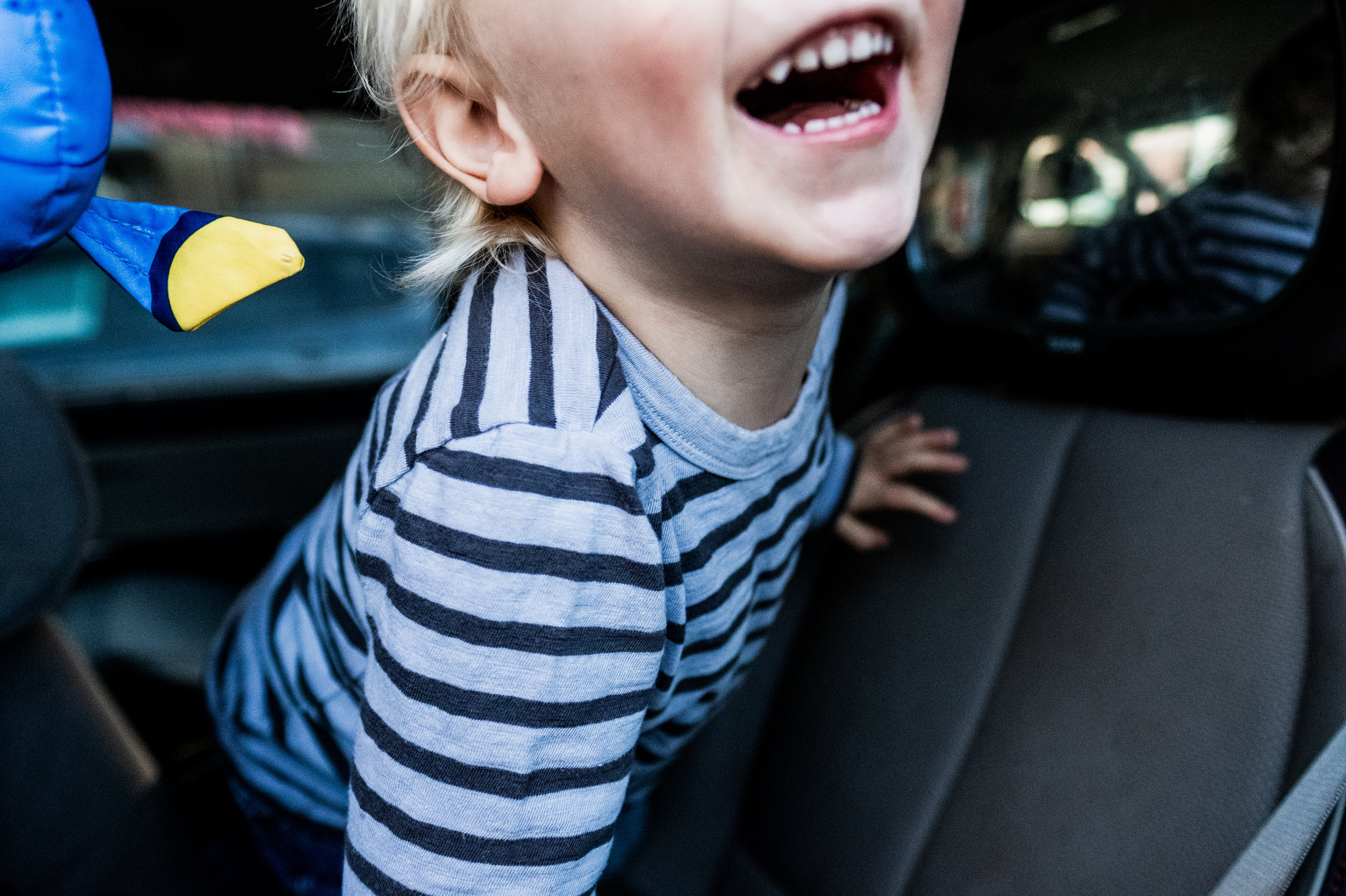 boy-in-car-smile-open-mouth-carseat-toddler