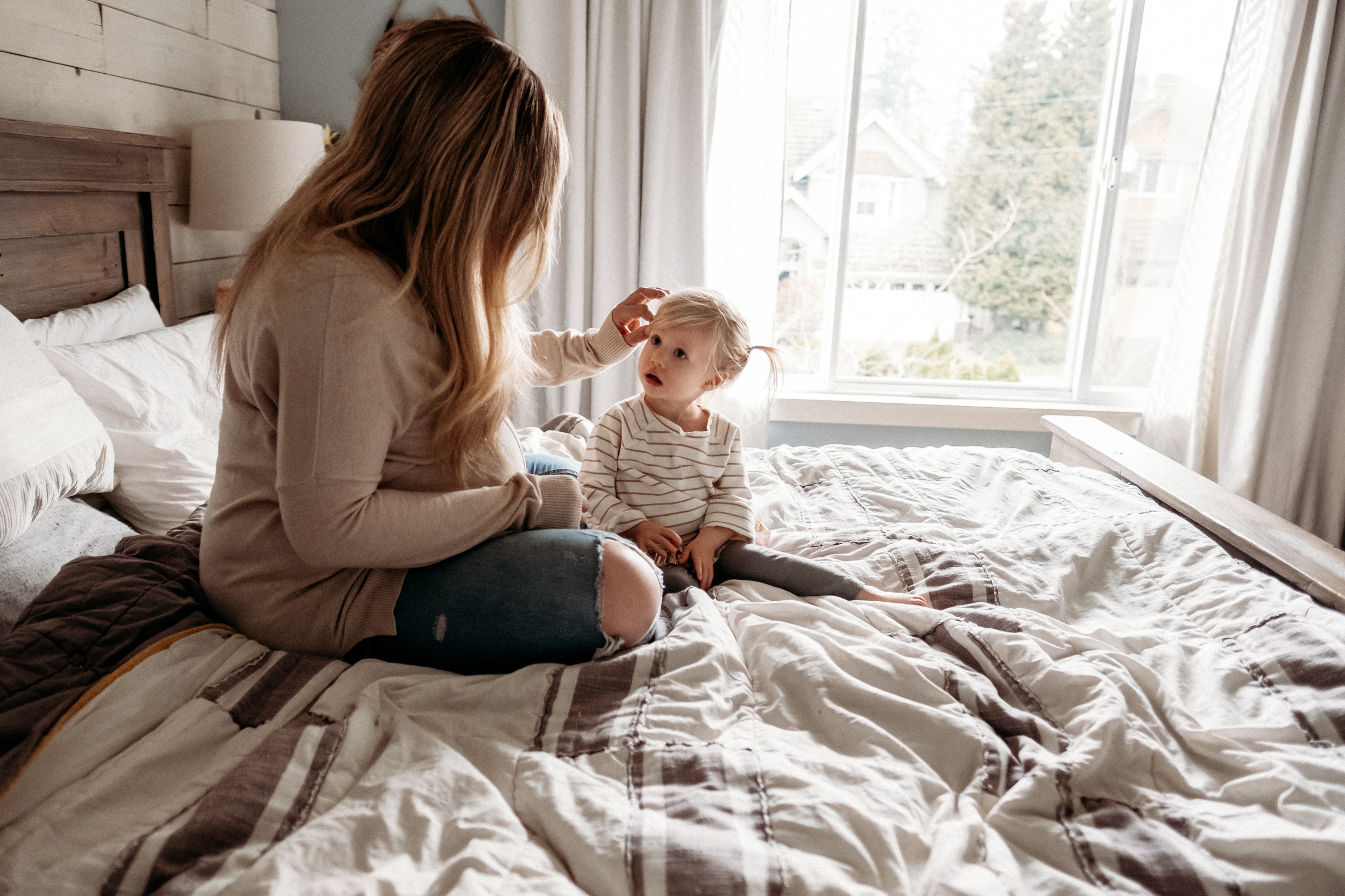 toddler-mom-bed-pregnant.jpg