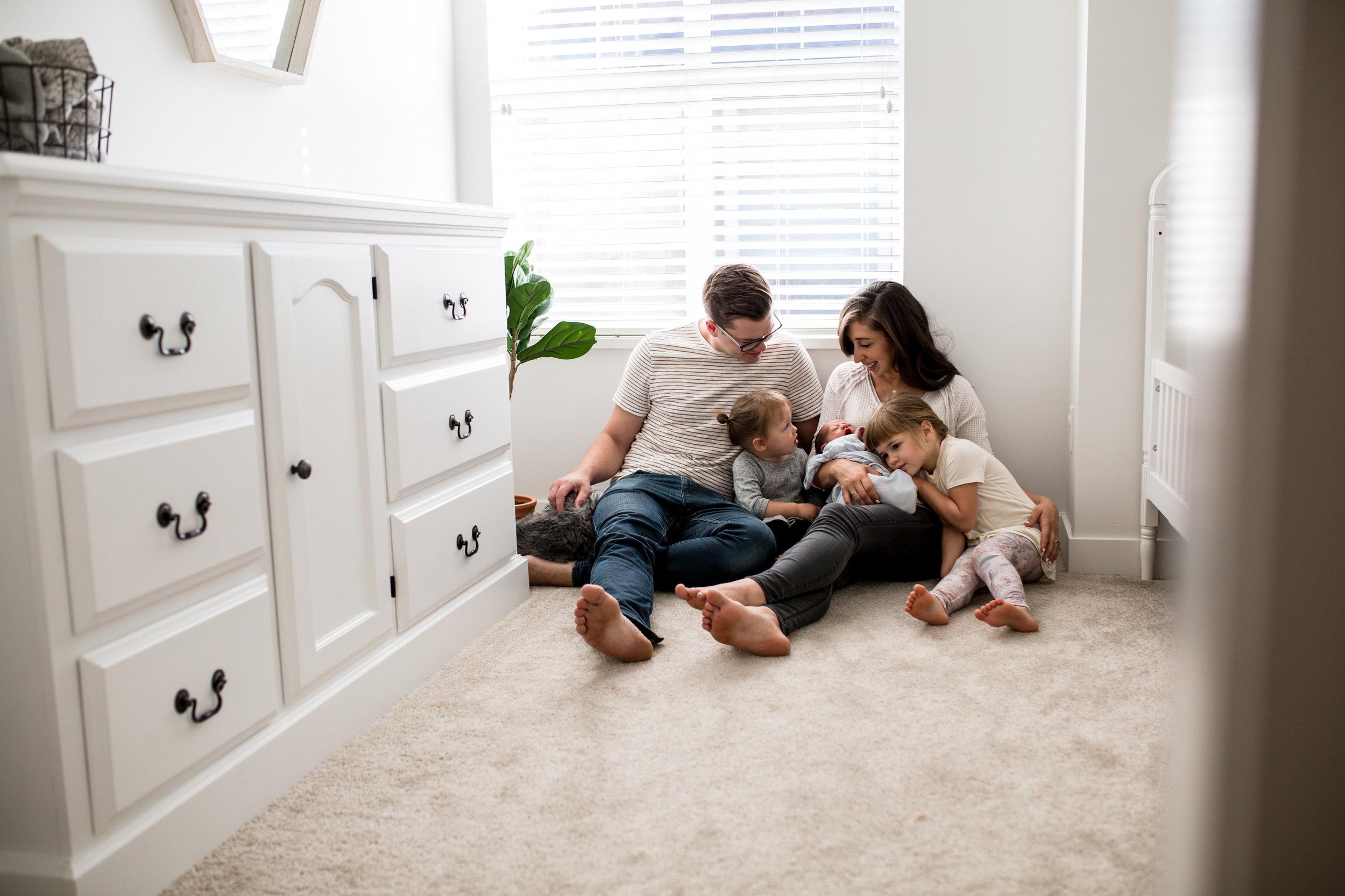 newborn photography family bedroom floor