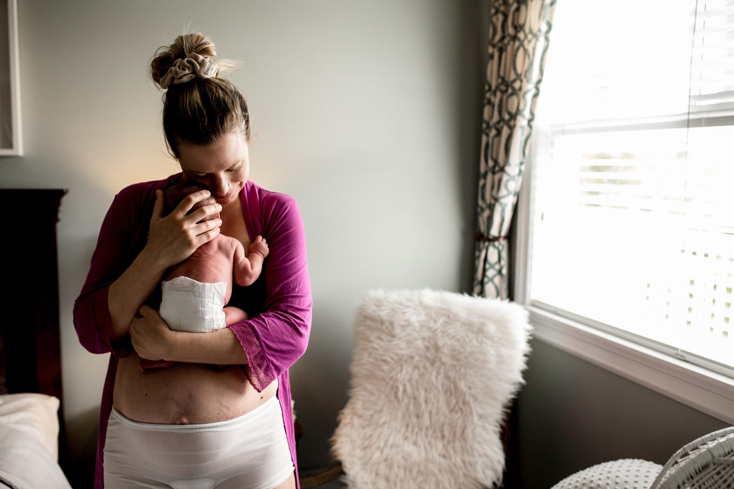 woman-hugging-newborn-baby-standing.jpg