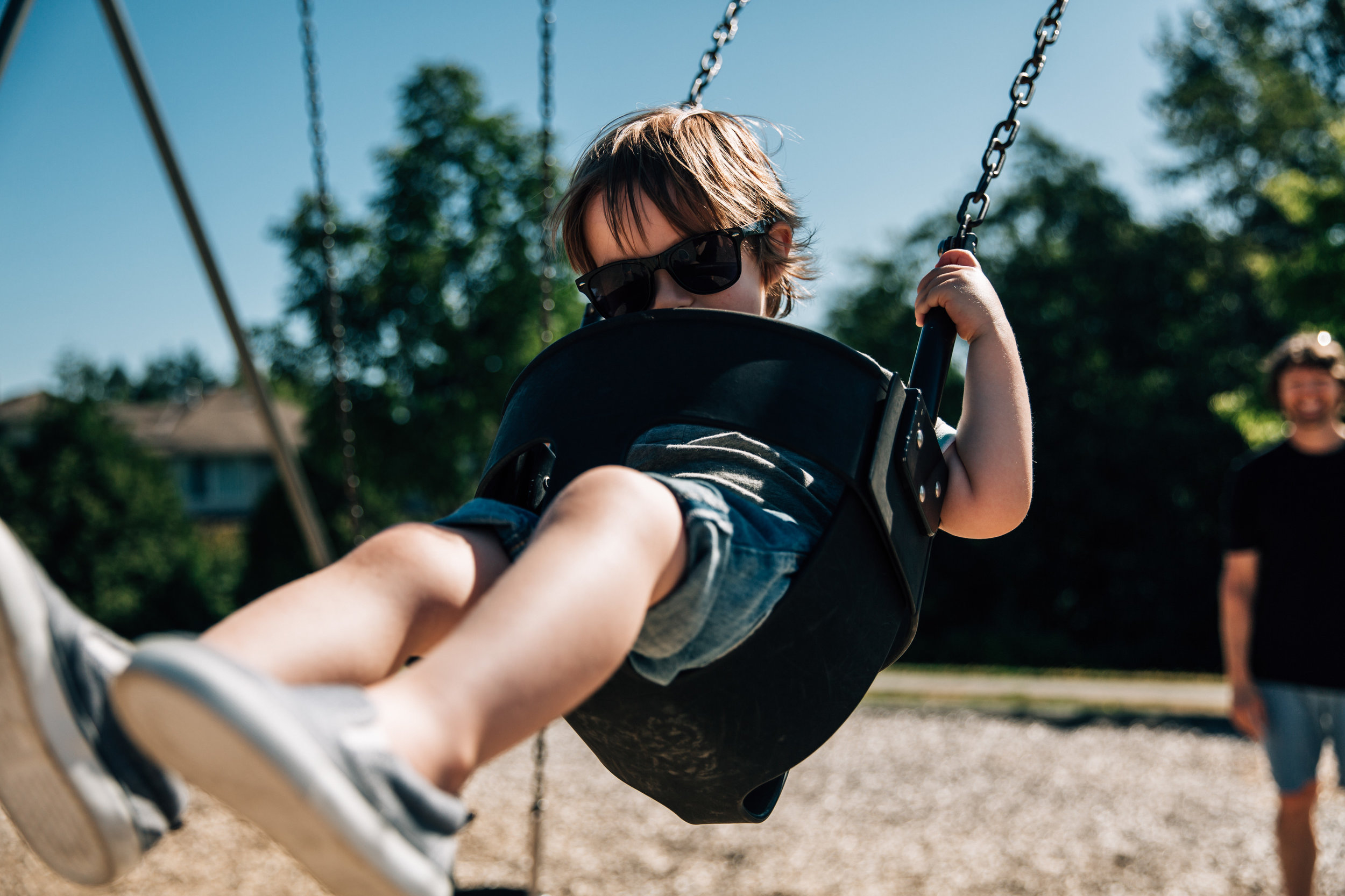 young toddler child on the swing