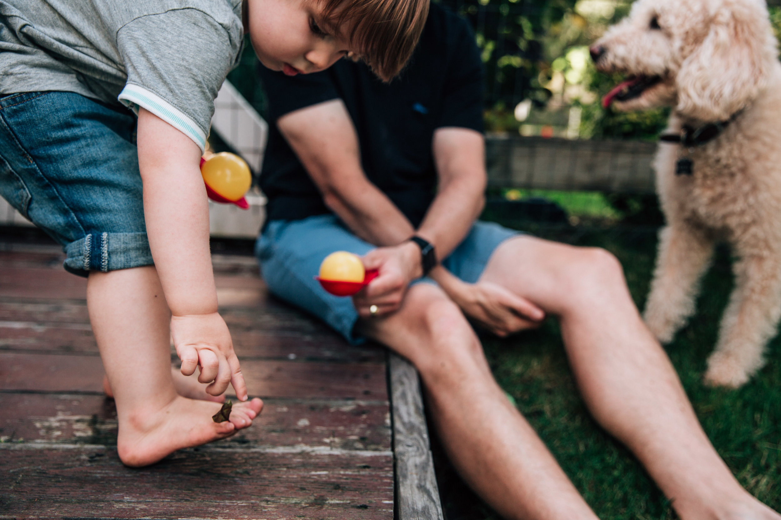 toddler has a leaf stuck in his toe