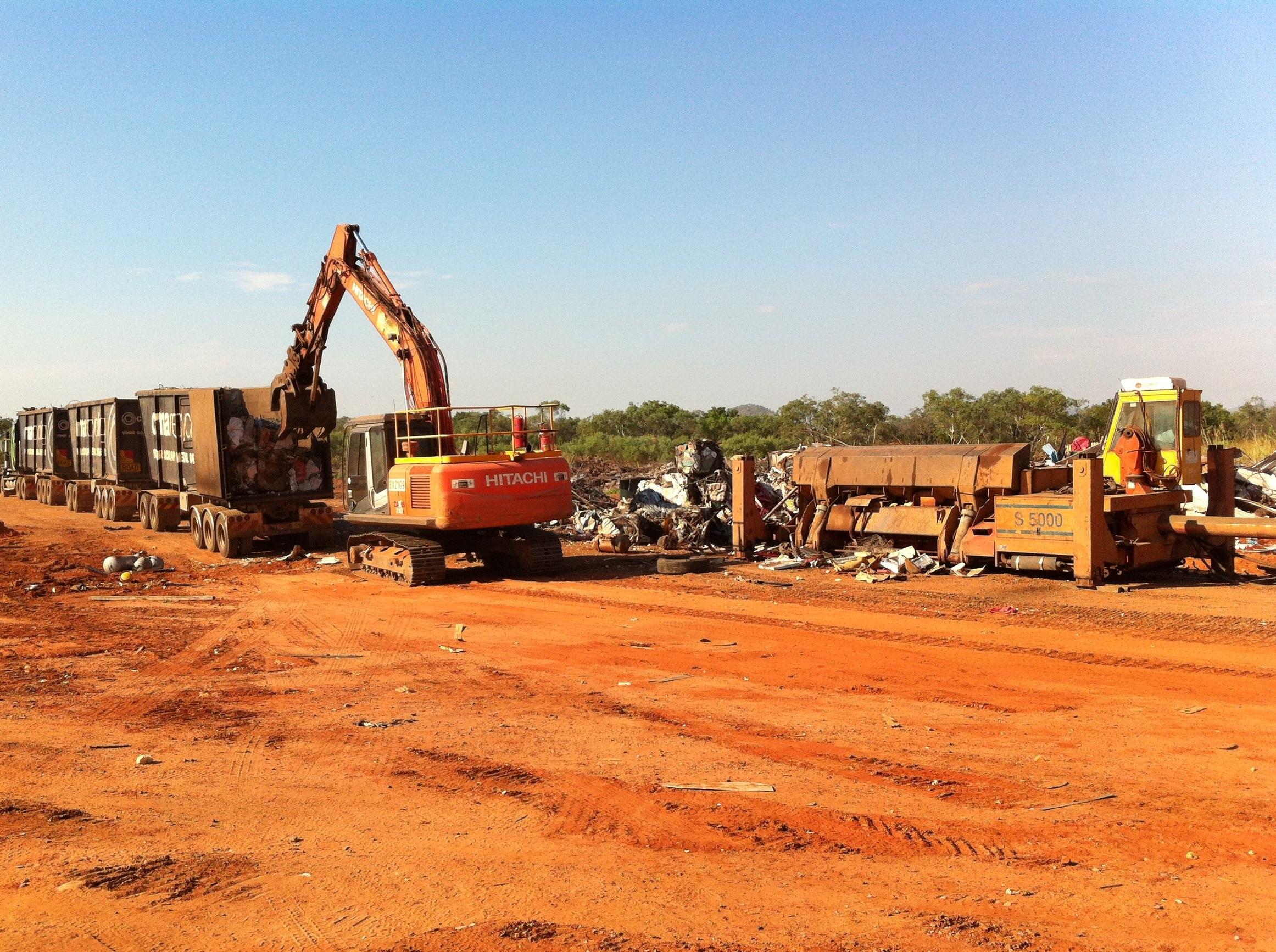 Scrap metal crusher and truck Apr13.jpg