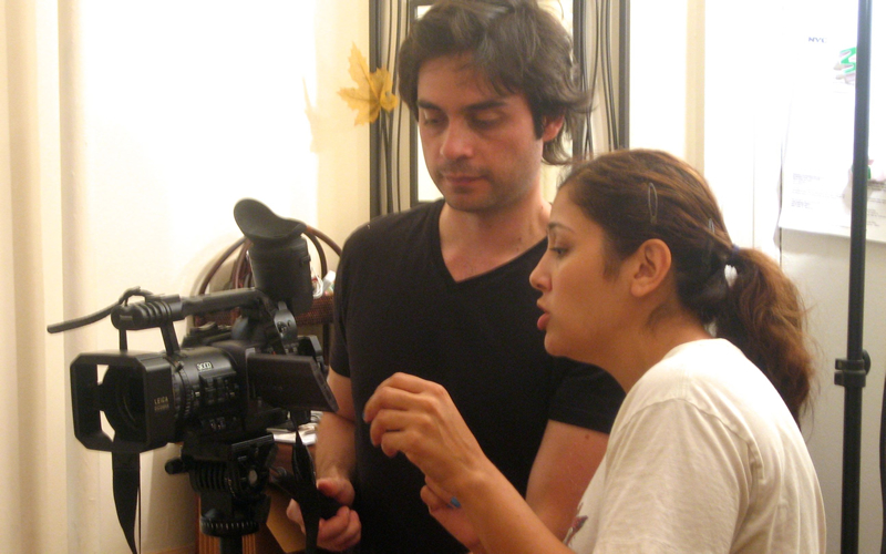 Framing up a shot with cinematographer Alain Aguilar.