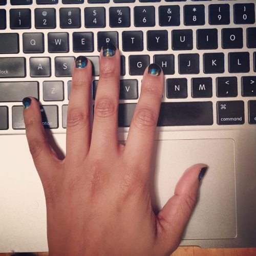 this is a photo of my hand and the fancy manicure i got. if i actually opened up, i'd tell you about the experience and how i am enamored with them and feel cool for actually getting my nails did, but alas, this post is about how i don't tell such stories most of the time.