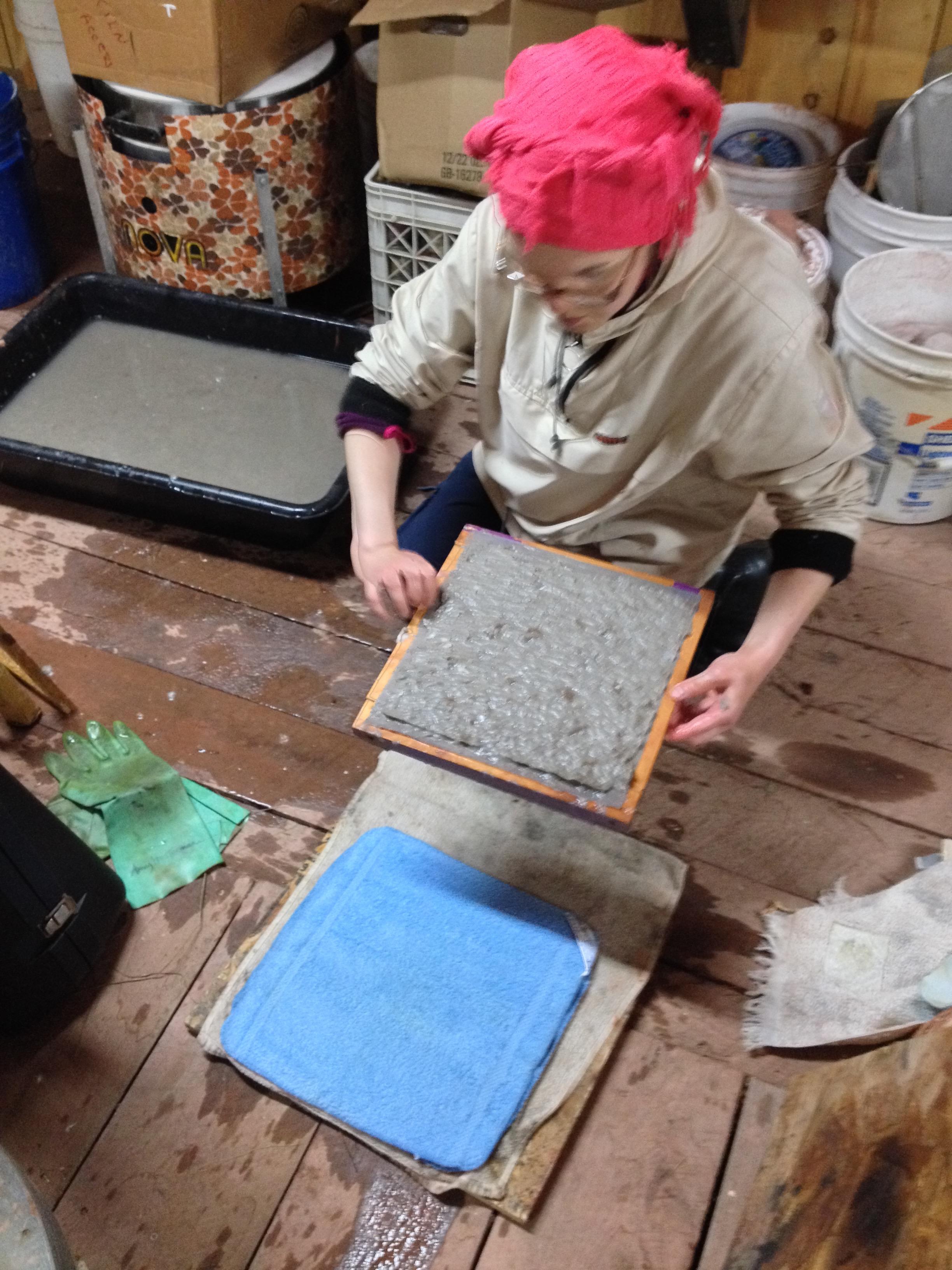 Mari making handmade recycled paper