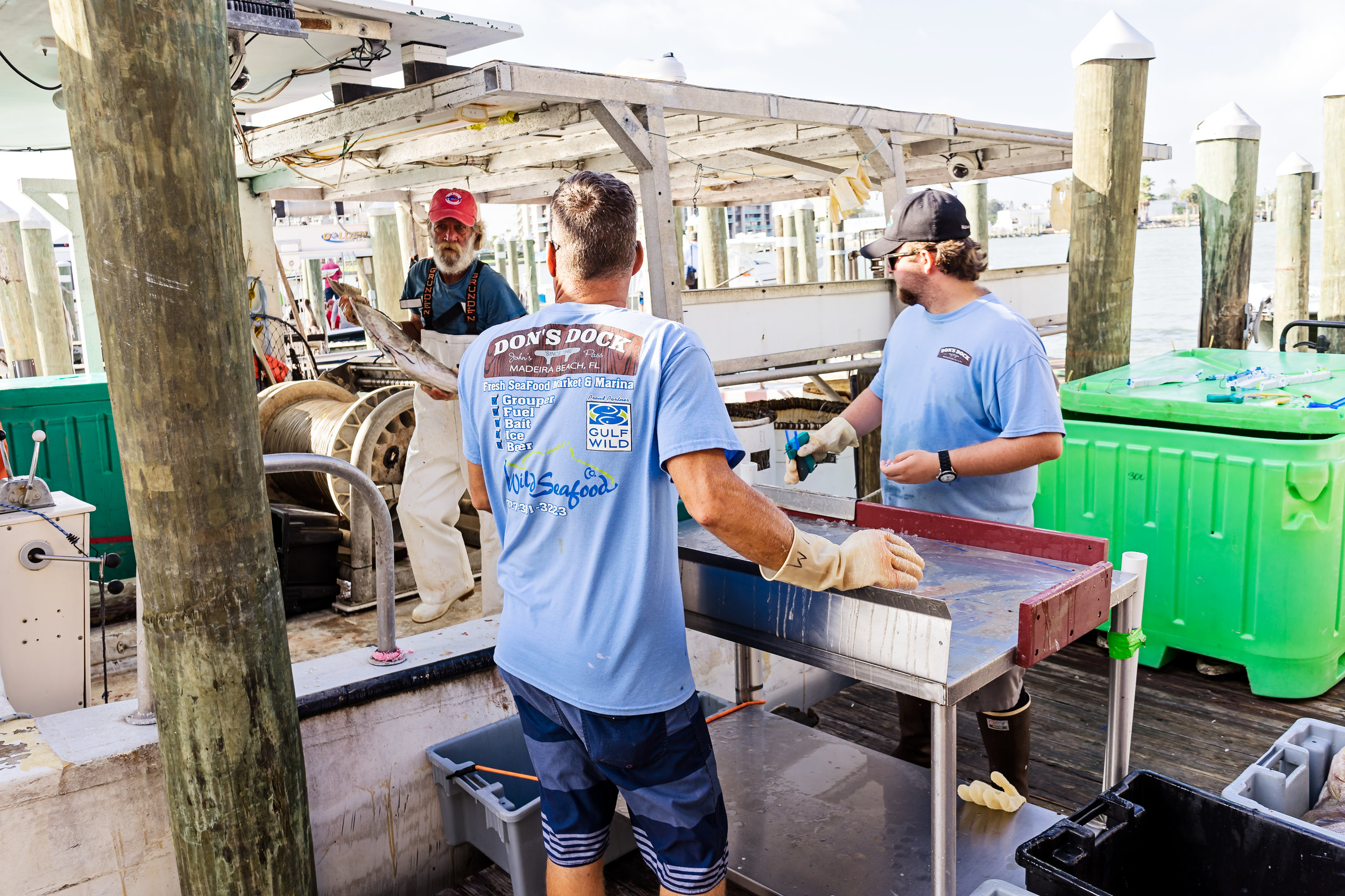 Chris Zook and Tyler Lavrinc sorting and tagging the fish as it comes off the boat.