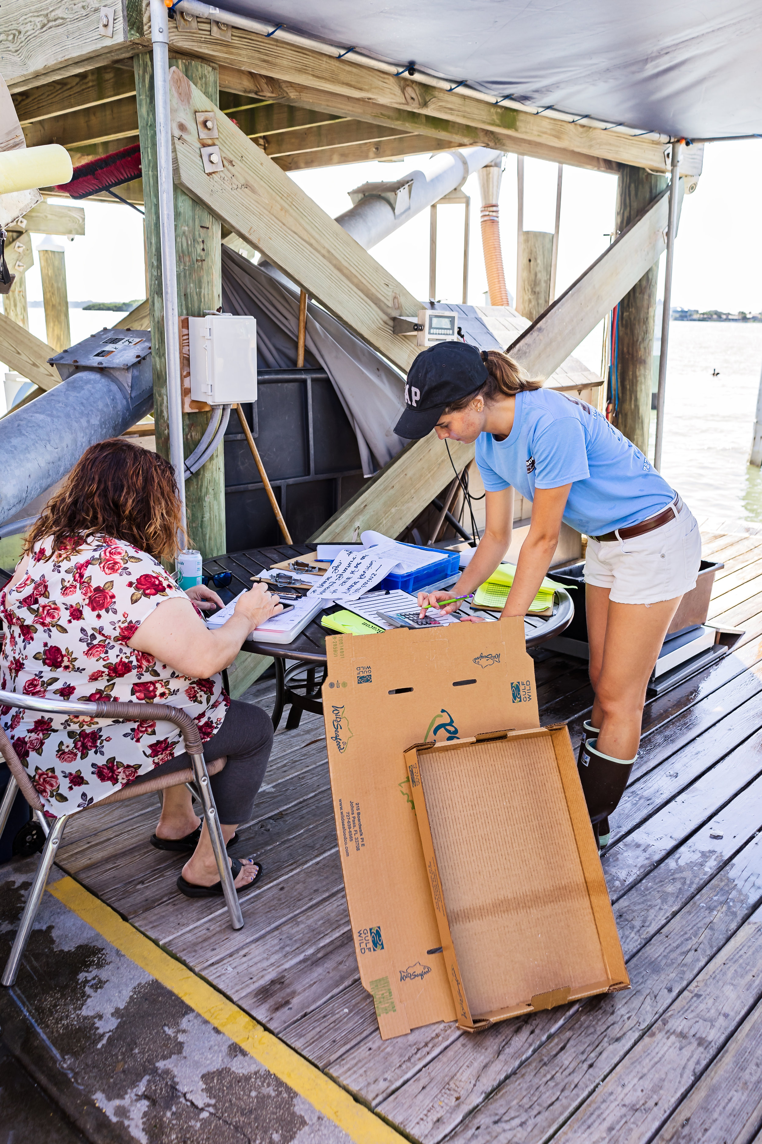 Erin Grebenev wrapping up paperwork for the day. Friday's catch totaled around 4,000 pounds of gulf fish.