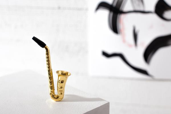 """When you wanna hit the high note, toot on this tiny saxophone-shaped pipe."""