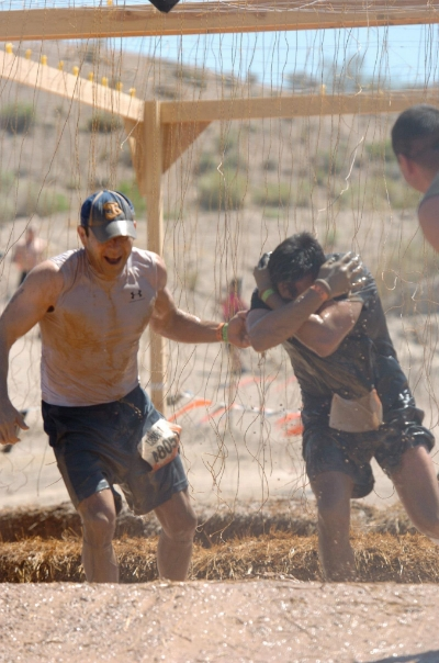 Pulling another Mudder through at my first event last year.