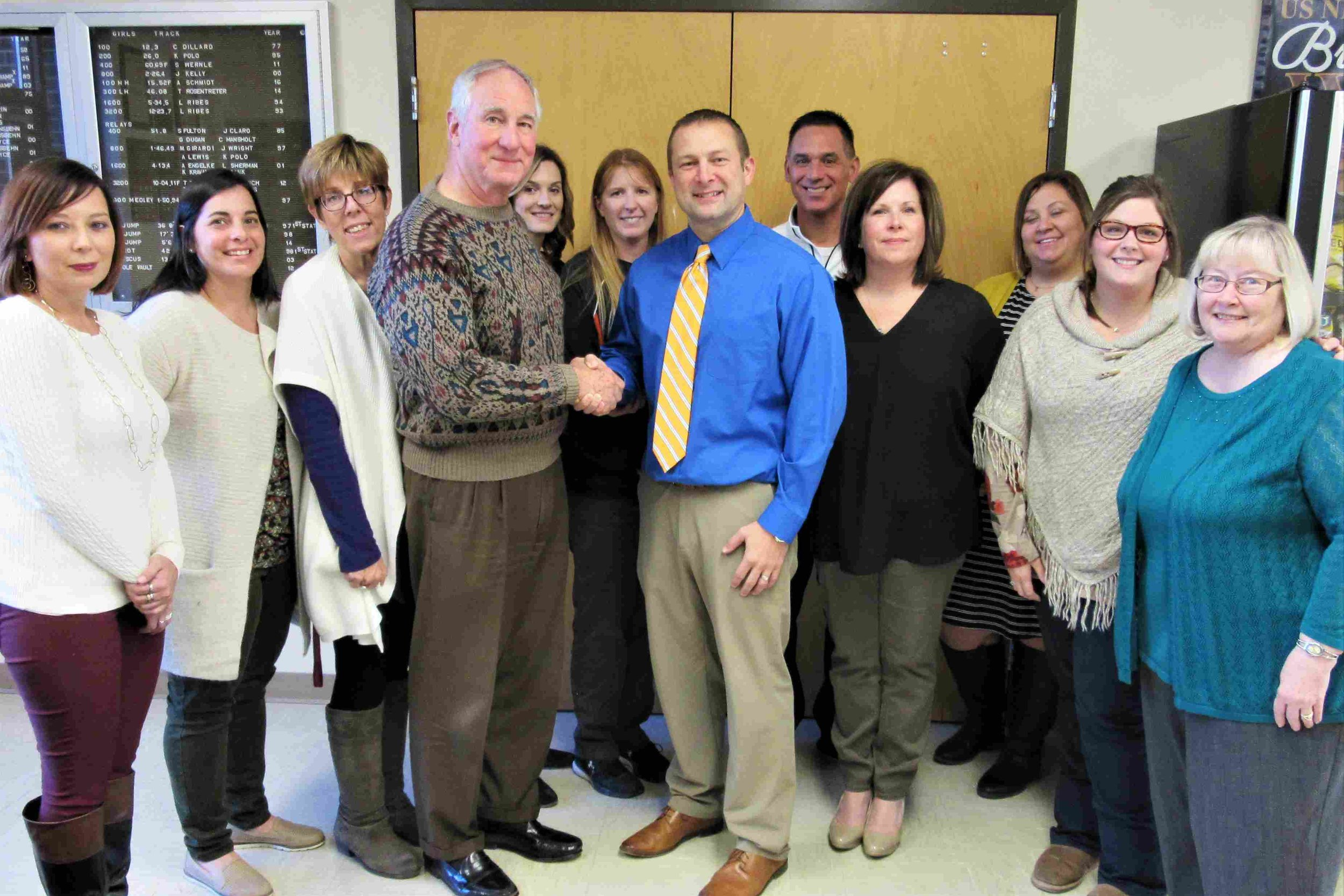(From left to right) Mary Kirk (Library and Speech), Michelle Smith (Biology/Science), Katie Prange (English),John Fassero, Jr., President of The Partnership, Nikki Brawner (Art), Holley McFarland (Physical Education), Rob Macias (Physical Education), Mr. Shane Owsley (High School Principal), Amy Goldasich (English), Andrea Williamson (English/Drama Club), Nickie Stoecker (Yearbook), Nanci Grandone, founder and past president of The Partnership