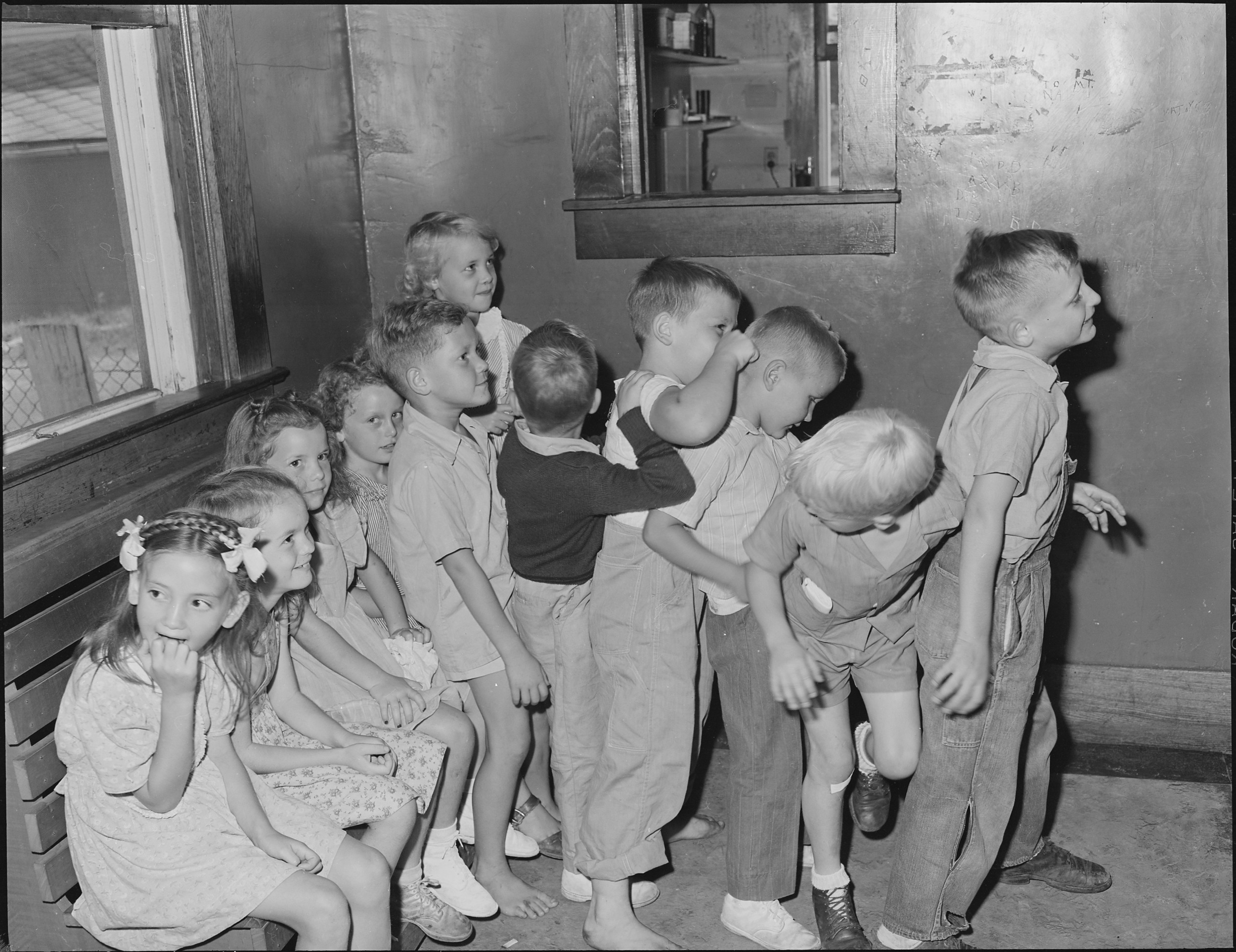 Children waiting for smallpox vaccinations and pre-school examinations (Virginia 1943).