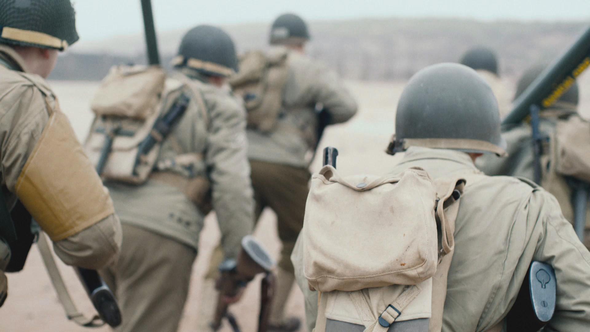 backs of soldiers running.jpg