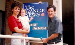 """That's us in 1997 with our daughter Maggie. We had just put our first paper """"to bed""""."""