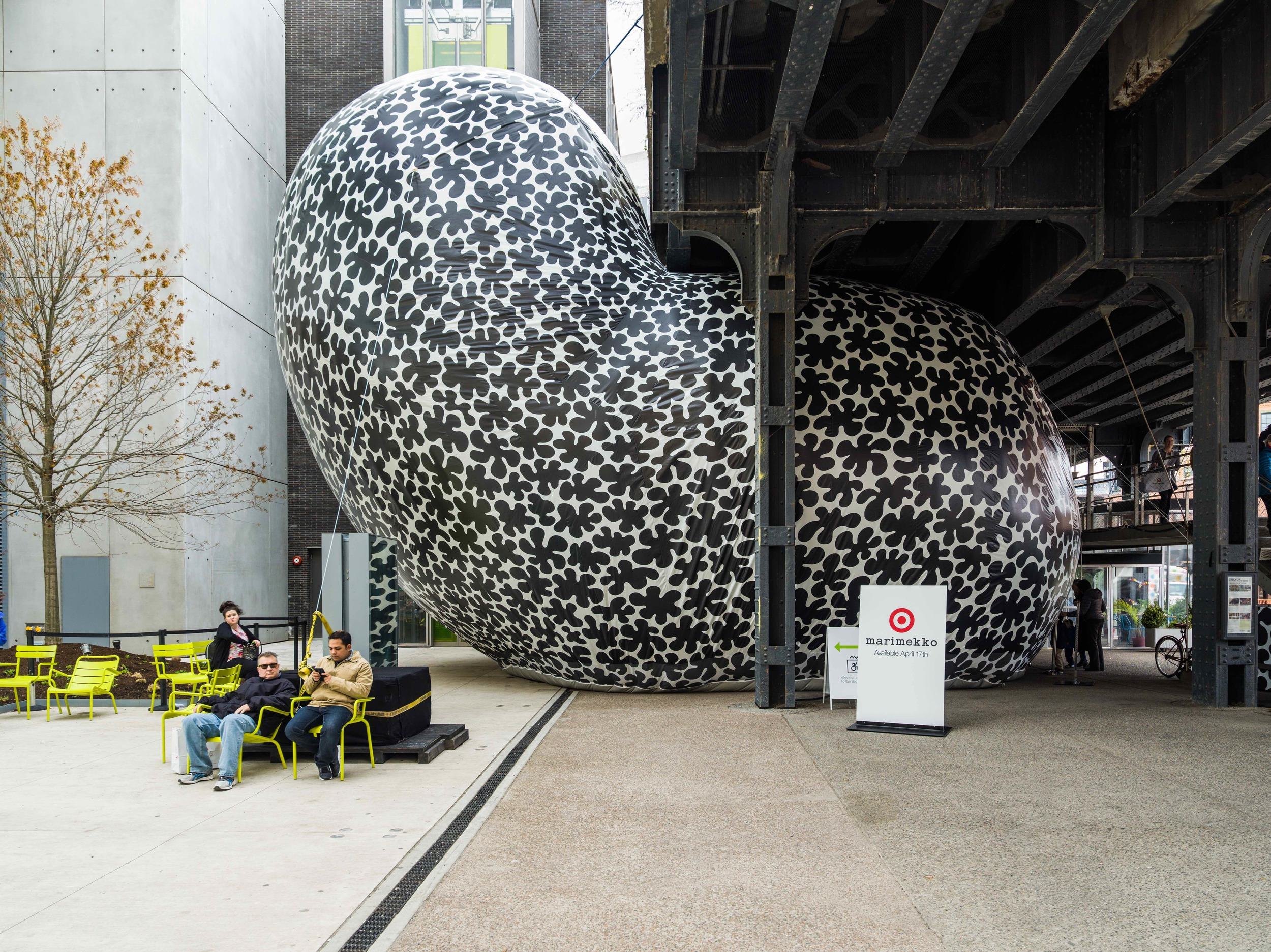 Koppelo Pouf is an asymmetric world covered in black and white dots. Guests lie on large memory foam forms beneath a mirrored ceiling. Surrounded by the Koppelo pattern, they snap their image in the mirrors hanging from the ceiling.