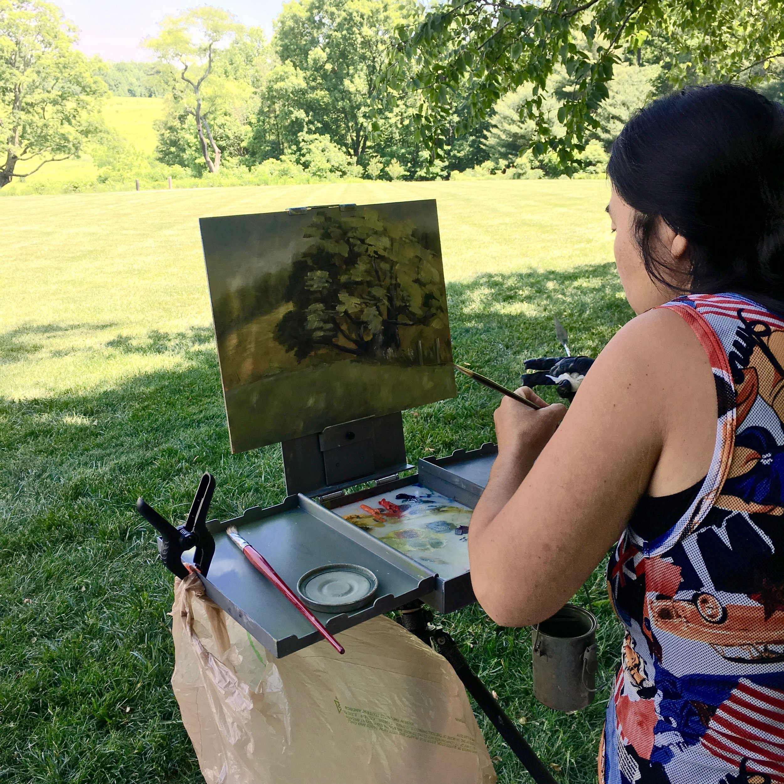 Jane Zhang proudly signing her first plein air painting.
