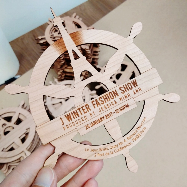 VIP invitations for Jessica Minh Anh show in Paris. Laser cut and engraved from 3mm cherry veneer MDF.