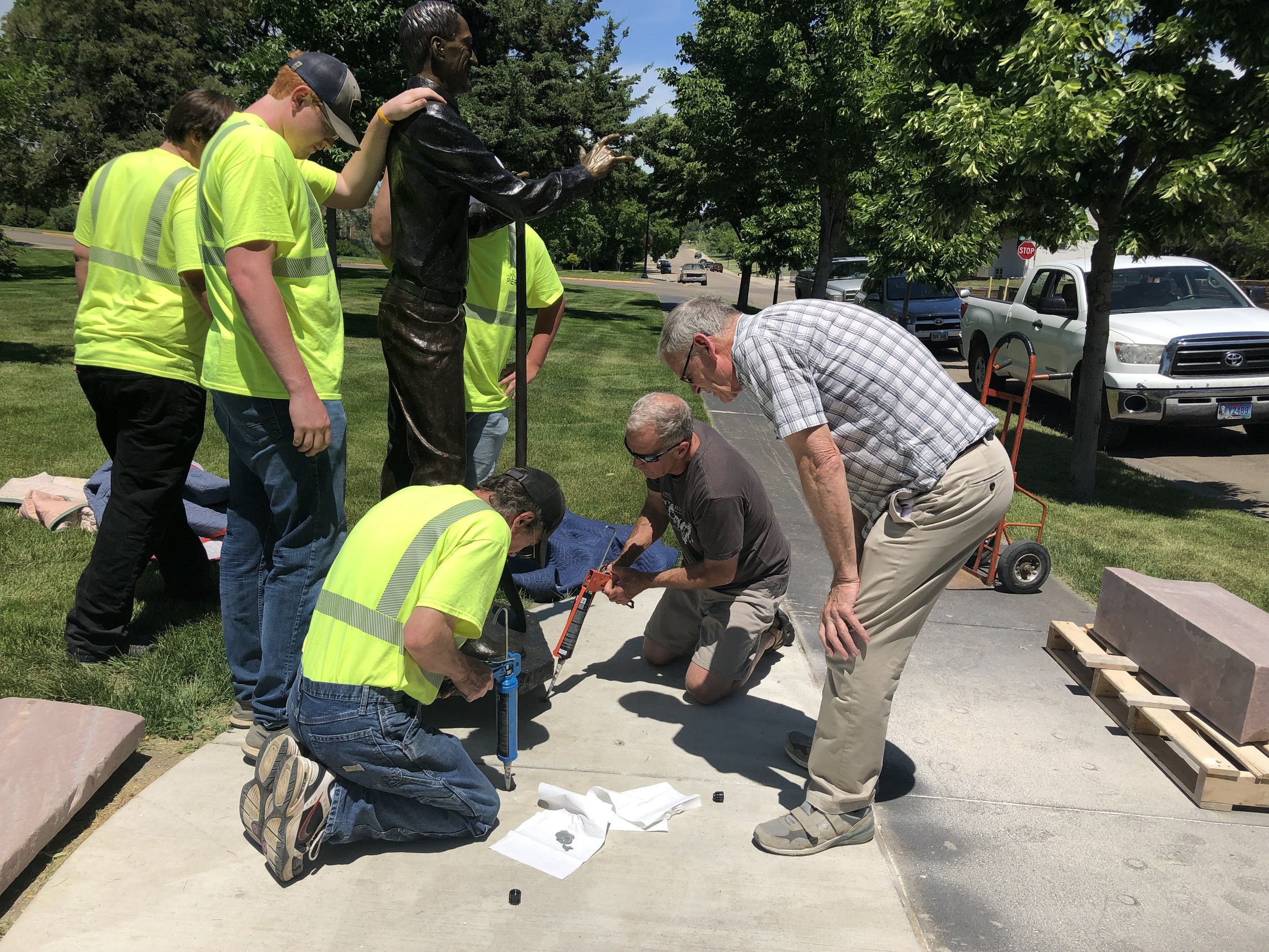 Chris Classen and the City of Pierre crew installing with me.  Trail of Governors sachem Leroy Foster supervising.