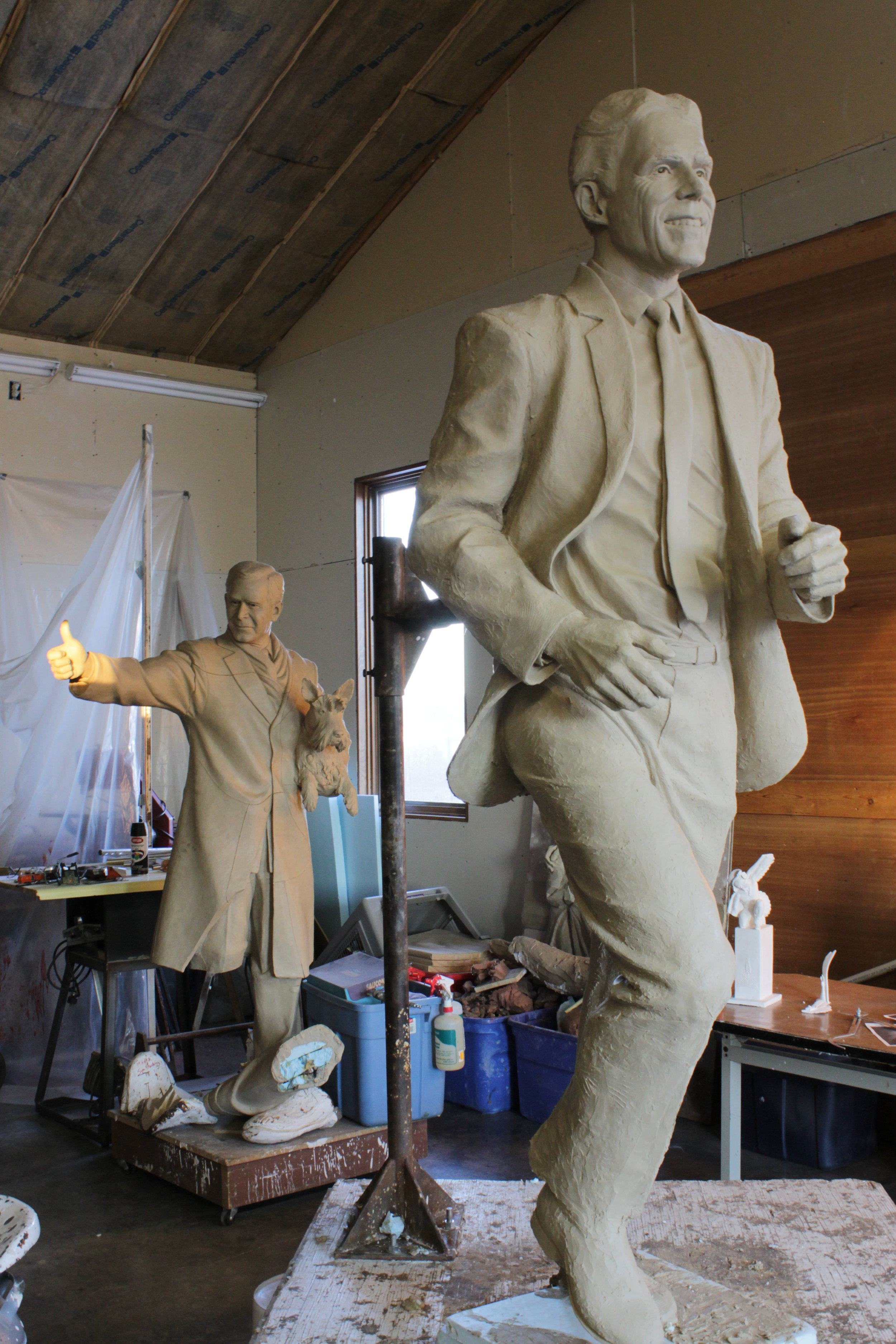 I ran across this picture of Frank's sculpture in progress, with the remnants of the George W. Bush clay in the background. W seems to approve of it so far.
